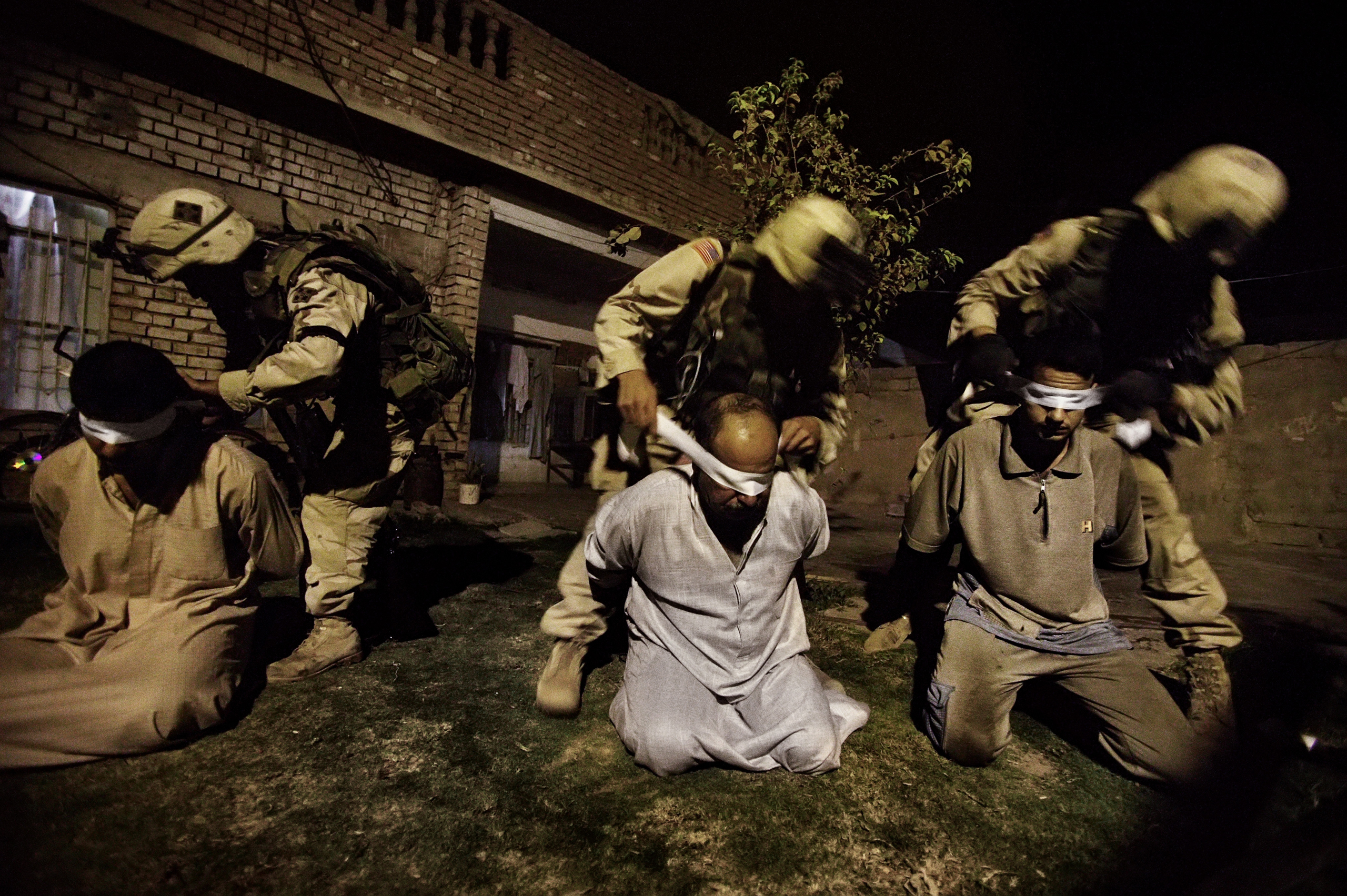 American soldiers of the 1st Battalion of the Fourth Division of the U.S. Army blindfold men suspected of being arms and explosive dealers in Tikrit, the birthplace of  Saddam Hussein and stronghold of his Baathist party, Sept, 24, 2003. Baathists began collaborating with al-Qaeda in Iraq, an insurgency group that was the forerunner of the Islamic State (ISIS), soon after Saddam Hussein was ousted in 2003.