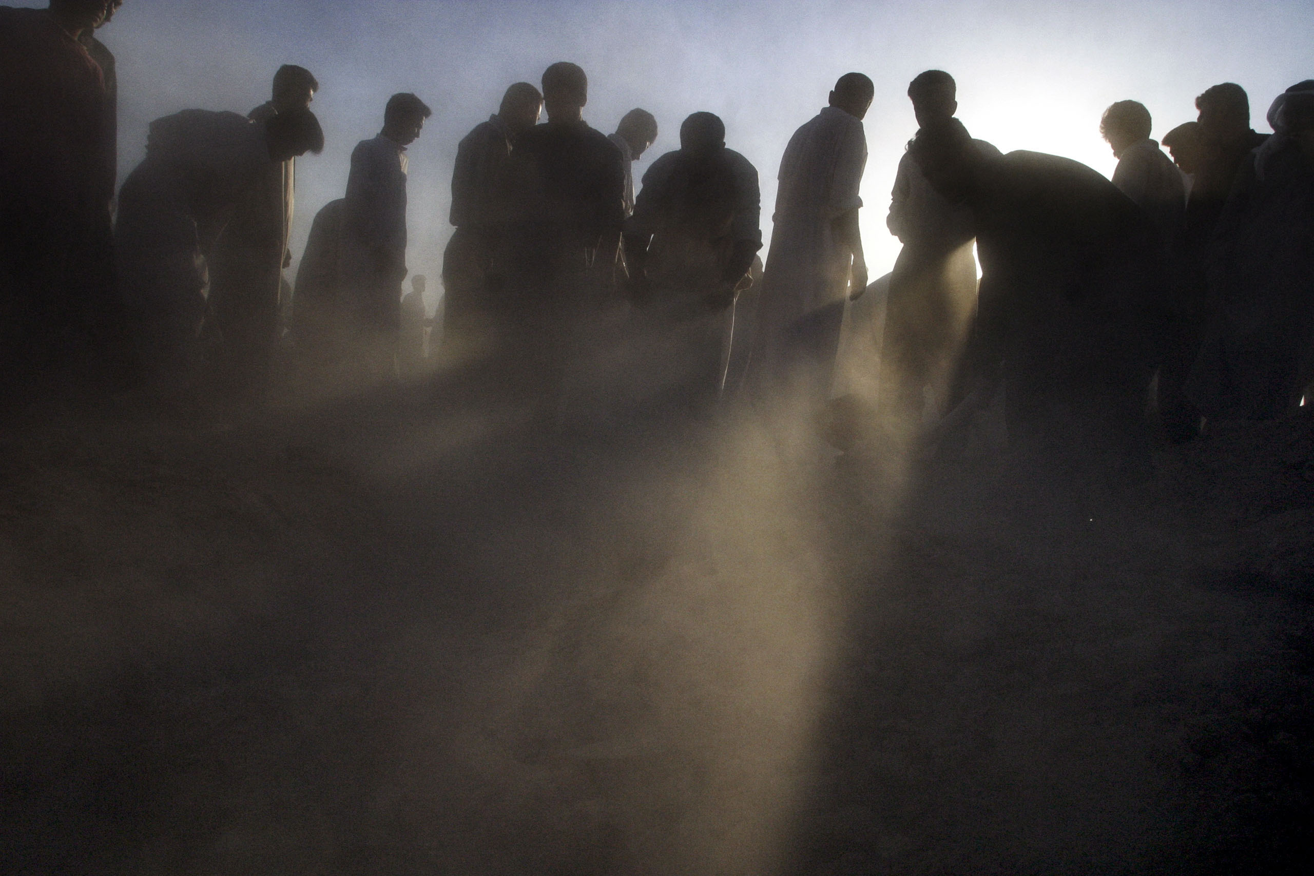 Iraqi mourners at a funeral in Fallujah, Iraq, for a man who was killed by American troops after they fired on a crowd of anti-American protesters, April 30, 2003.