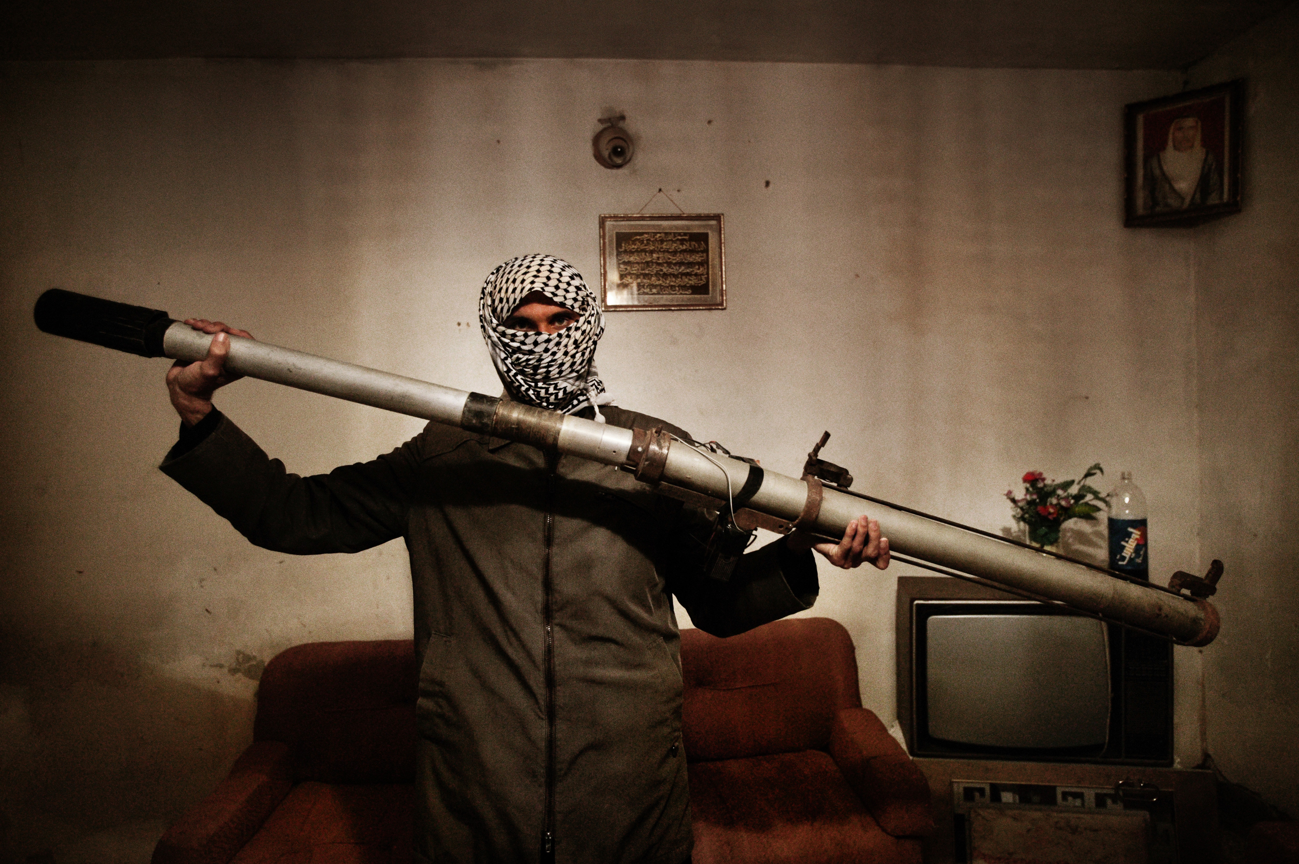 A member of a resistance network operating against U.S. forces in Iraq holds a modified launcher for surface-to-air missiles, Baghdad, Iraq, Dec. 4, 2003.