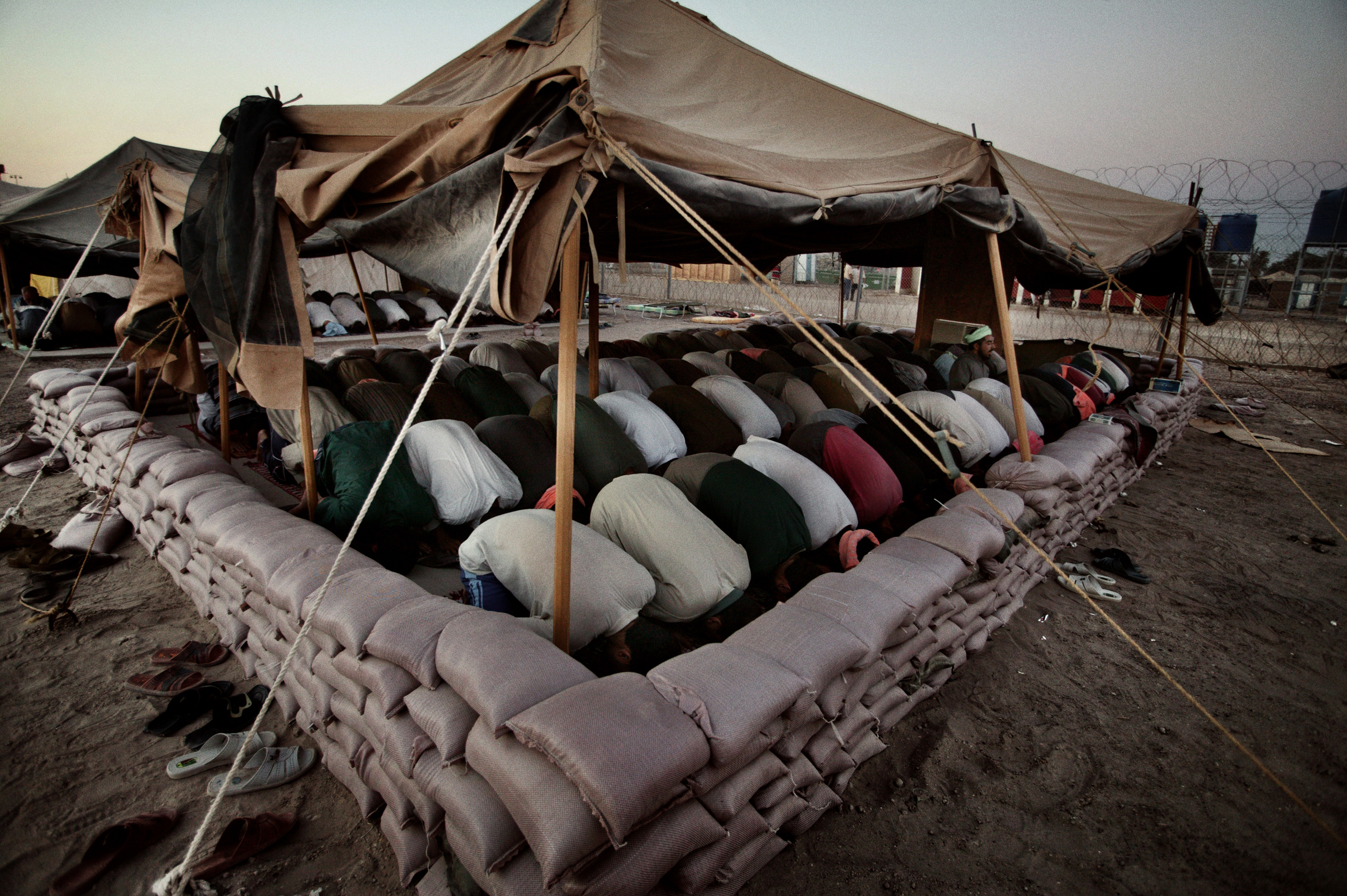 Friday prayer at Abu Ghraib prison on the outskirts of Baghdad, June 25, 2004.