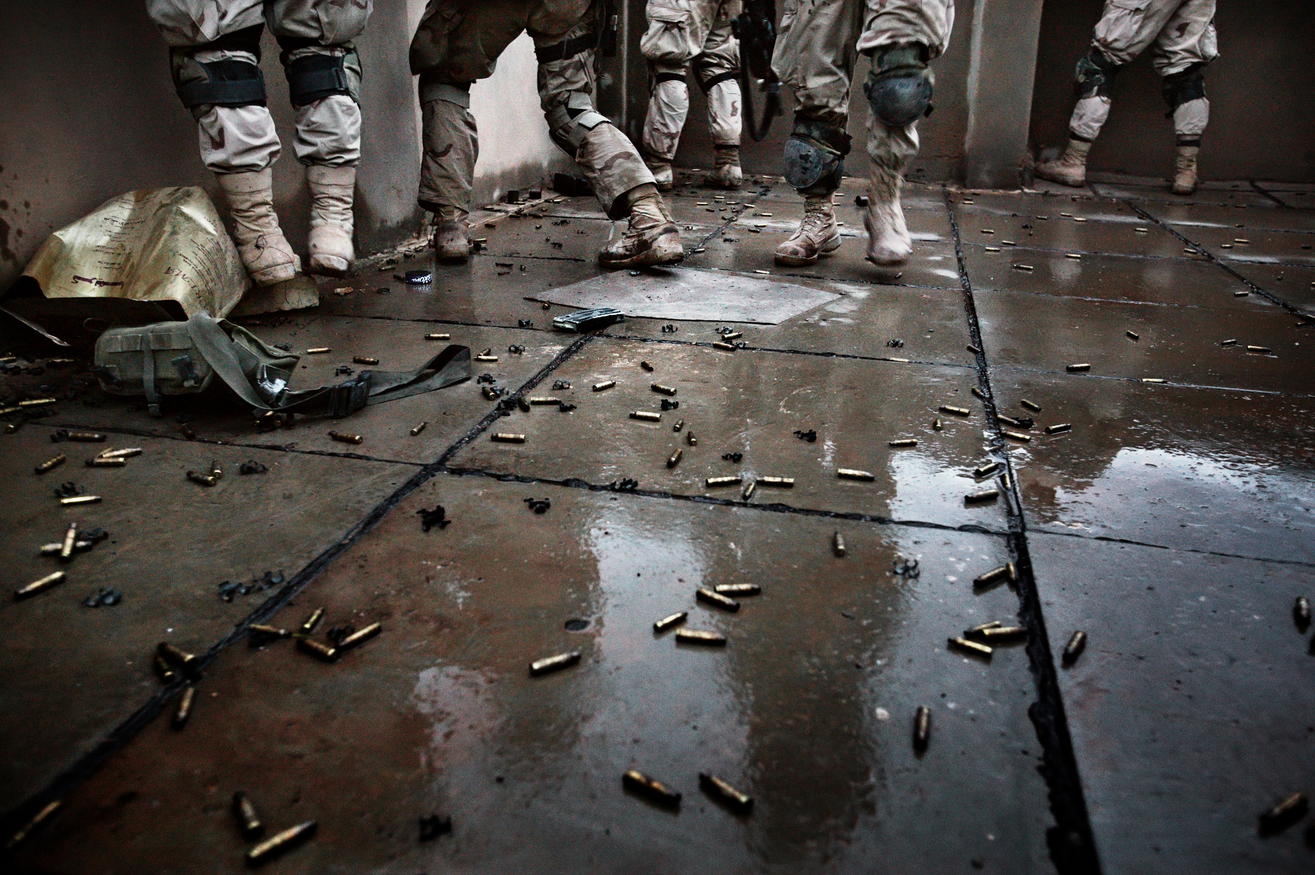 Shell casings line a rooftop where soldiers with the Army Task Force 2-2's Alpha Company, 3rd Platoon fight insurgents  during  a major offensive to clear the city of extremists, Fallujah, Nov. 9, 2004.