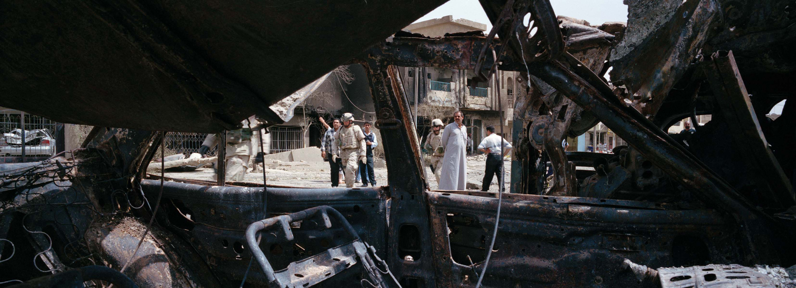 Wreckage of a suicide car bomb in Baghdad, Iraq, 2005.
