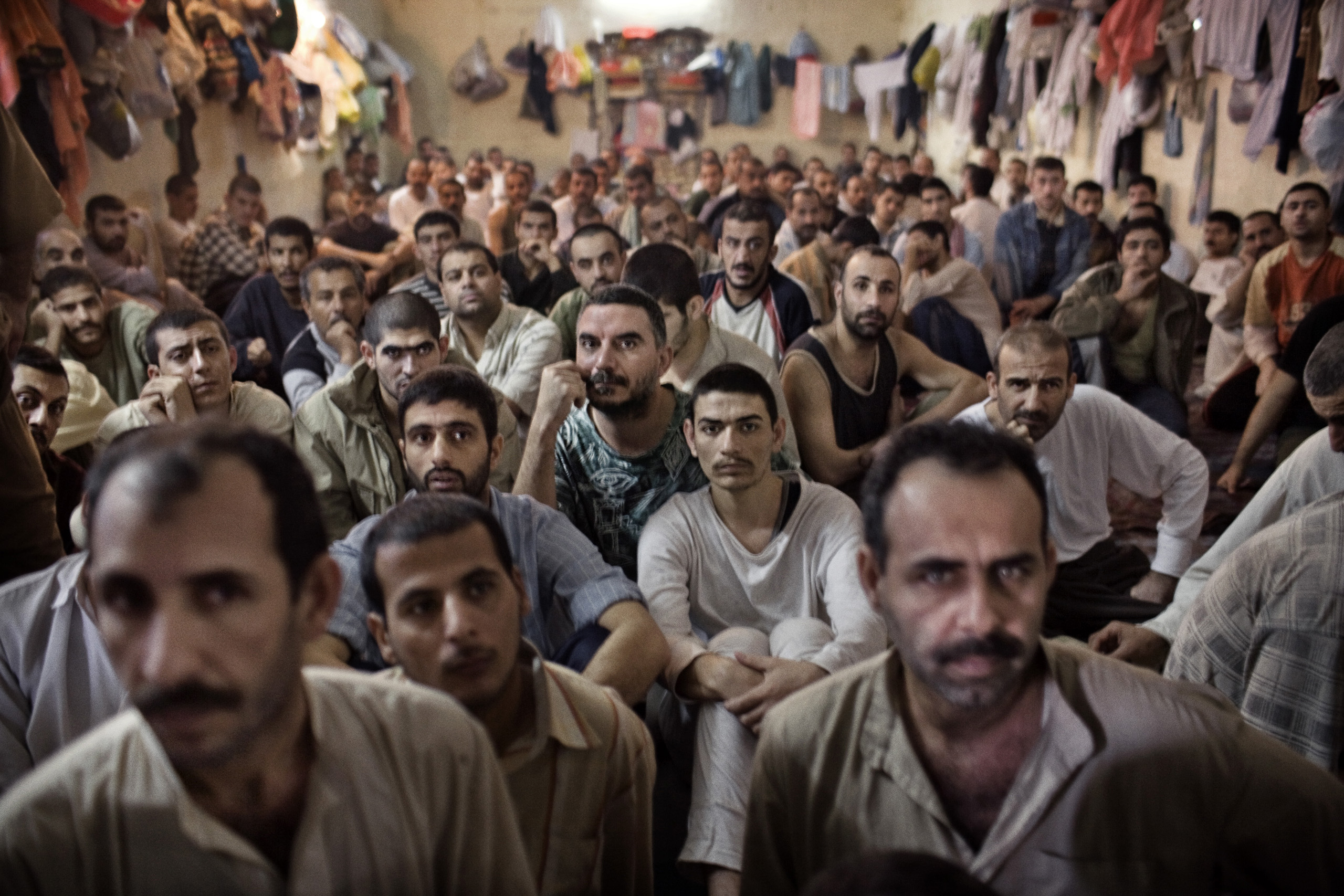 Iraqi prisoners are held in an overcrowded Interior Ministry prison, detained by the feared Iraqi police commandos, Wolf Brigade, an almost exclusively Shi'ite counter-insurgency unit, Baghdad, Iraq, Nov. 30, 2005.