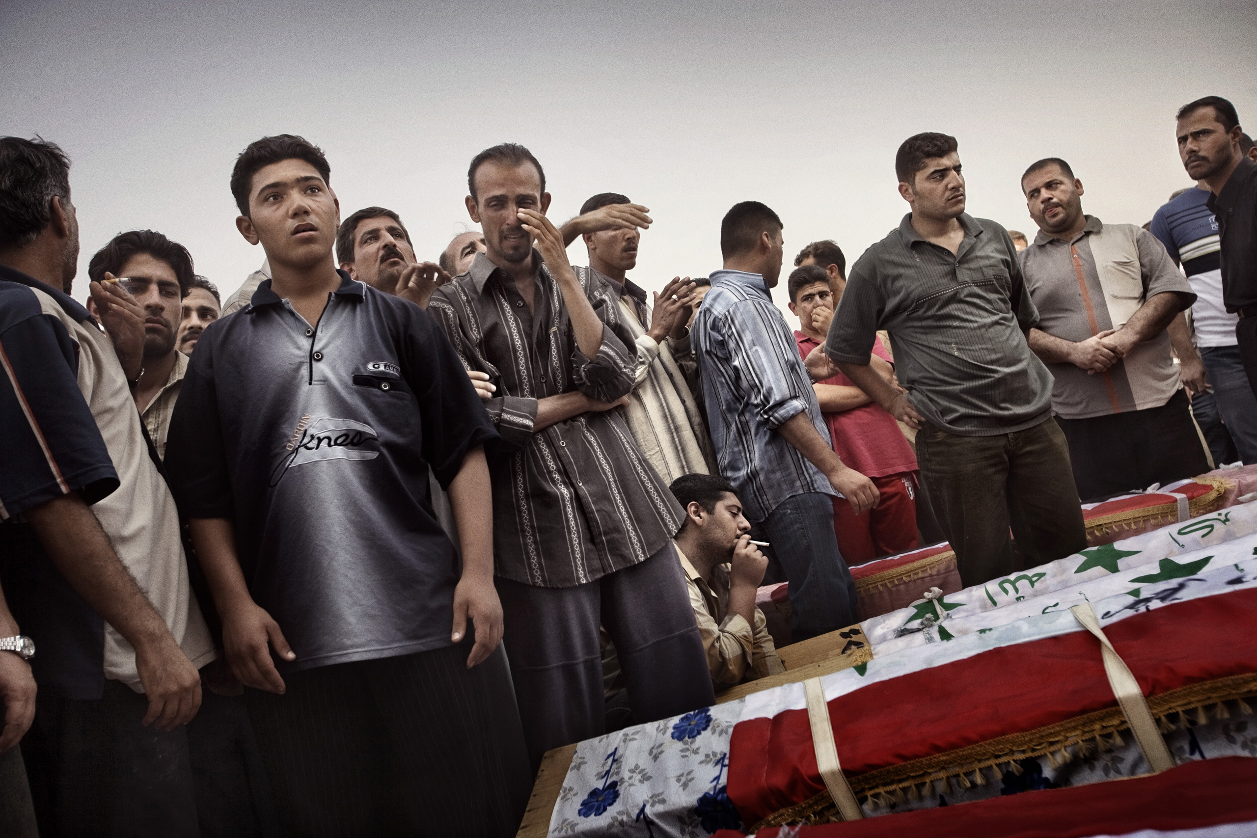 A funeral on Oct 7, 2005, in Baghdad, Iraq, for 22 men who were found handcuffed and shot dead in eastern Iraq. According to family members, the men, mostly Sunni, were taken from their homes by the special forces of the interior ministry, an almost exclusively Shi'ite counter-insurgency unit. They were found handcuffed and shot dead in a village on the Iraqi Iranian border, Oct. 5, 2005.