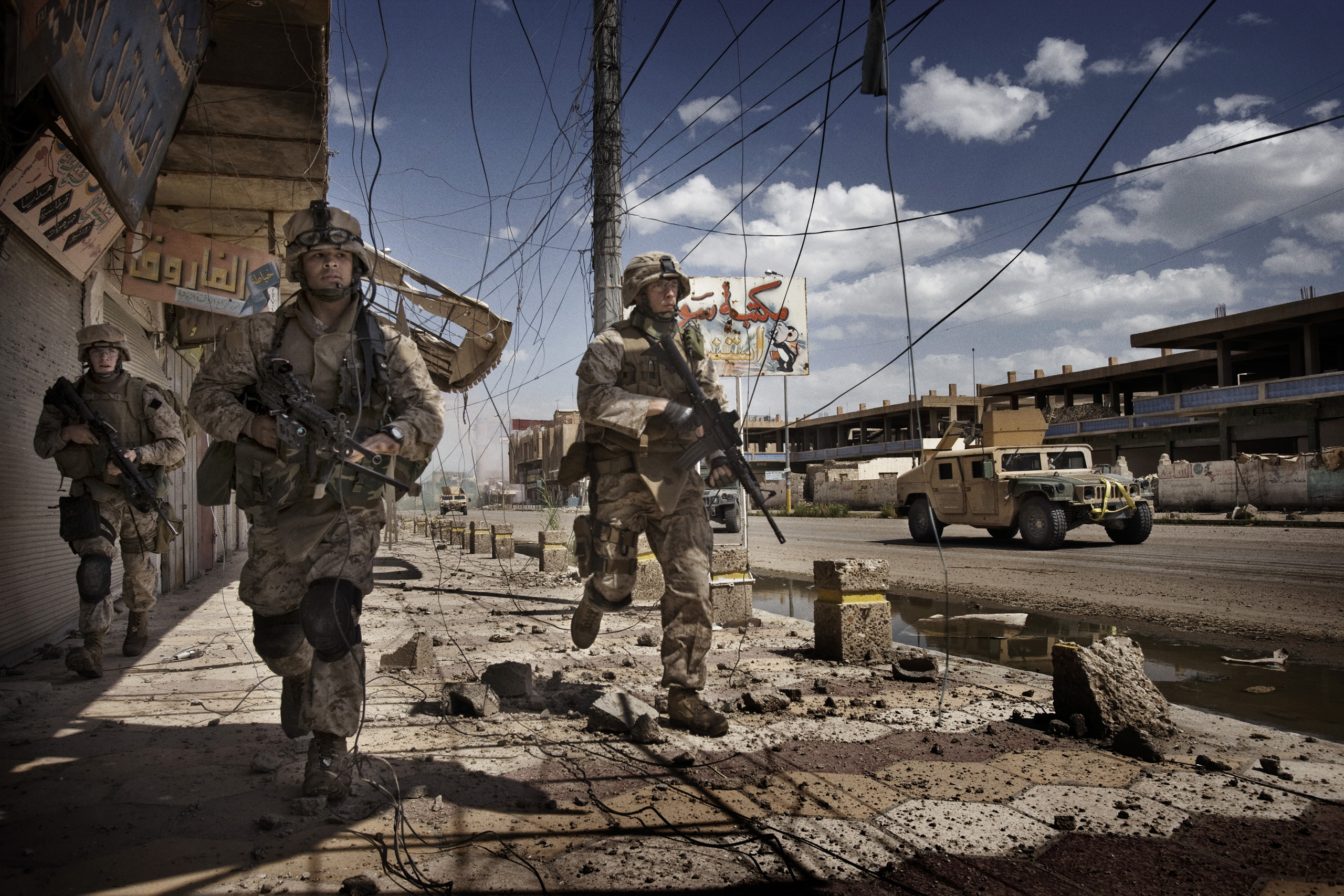 U.S. Marines from the 3rd Battalion, 8th Marine Regiment, Kilo company scan streets and surrounding buildings for insurgents during a patrol in Ramadi, Iraq, April 27, 2006.