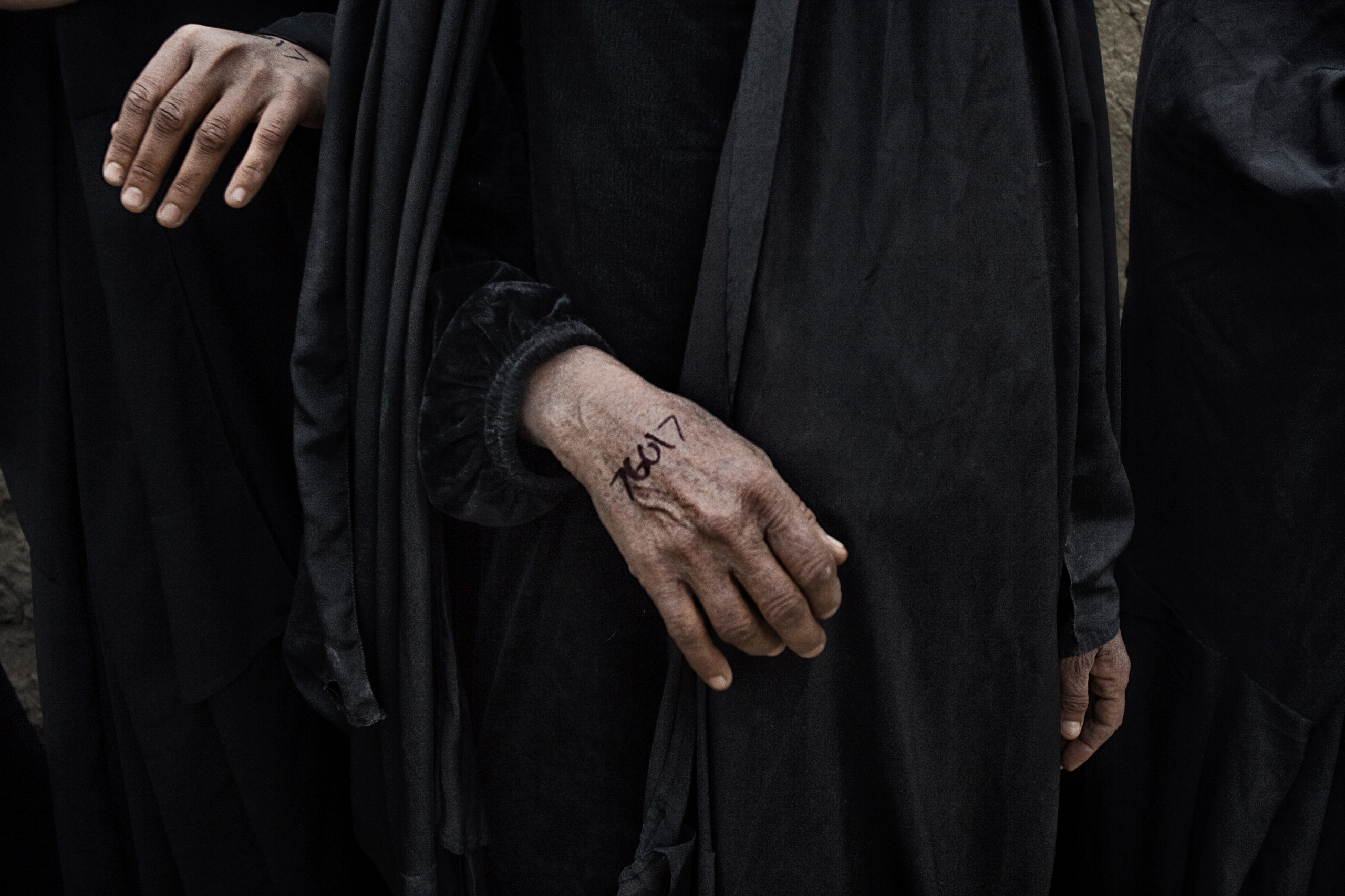 Numbers written on the hand of an Iraqi woman in Qubah, a village in Diyala Province, Iraq, March 24, 2007.
