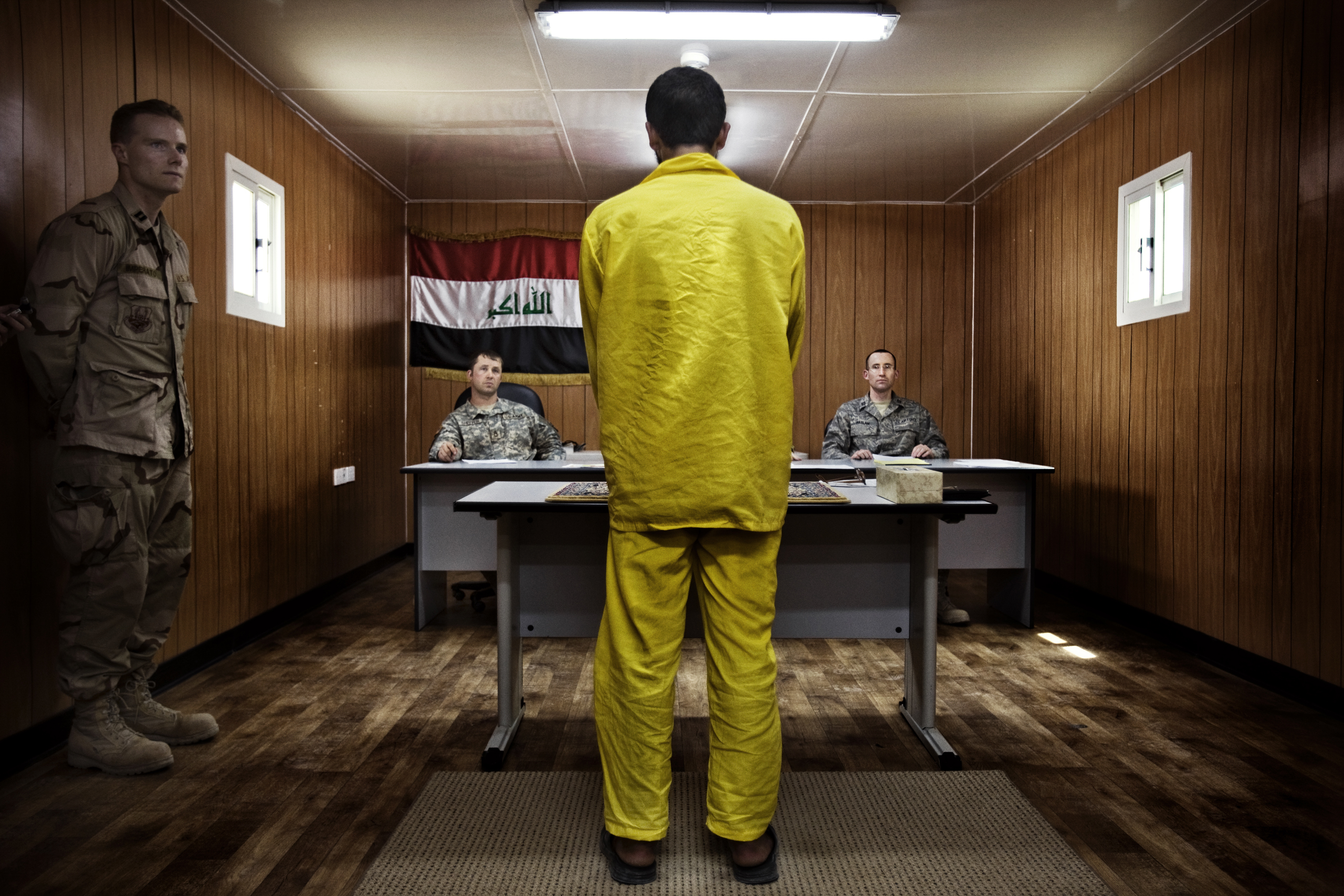 A panel of three American military officers question an Iraqi detainee at Camp Cropper, a U.S. military detention facility in Baghdad,  July, 26, 2008. Just under 21,000 Iraqis were held by the U.S. military, outside of the Iraqi justice system, under terms laid out by a U.N. mandate.