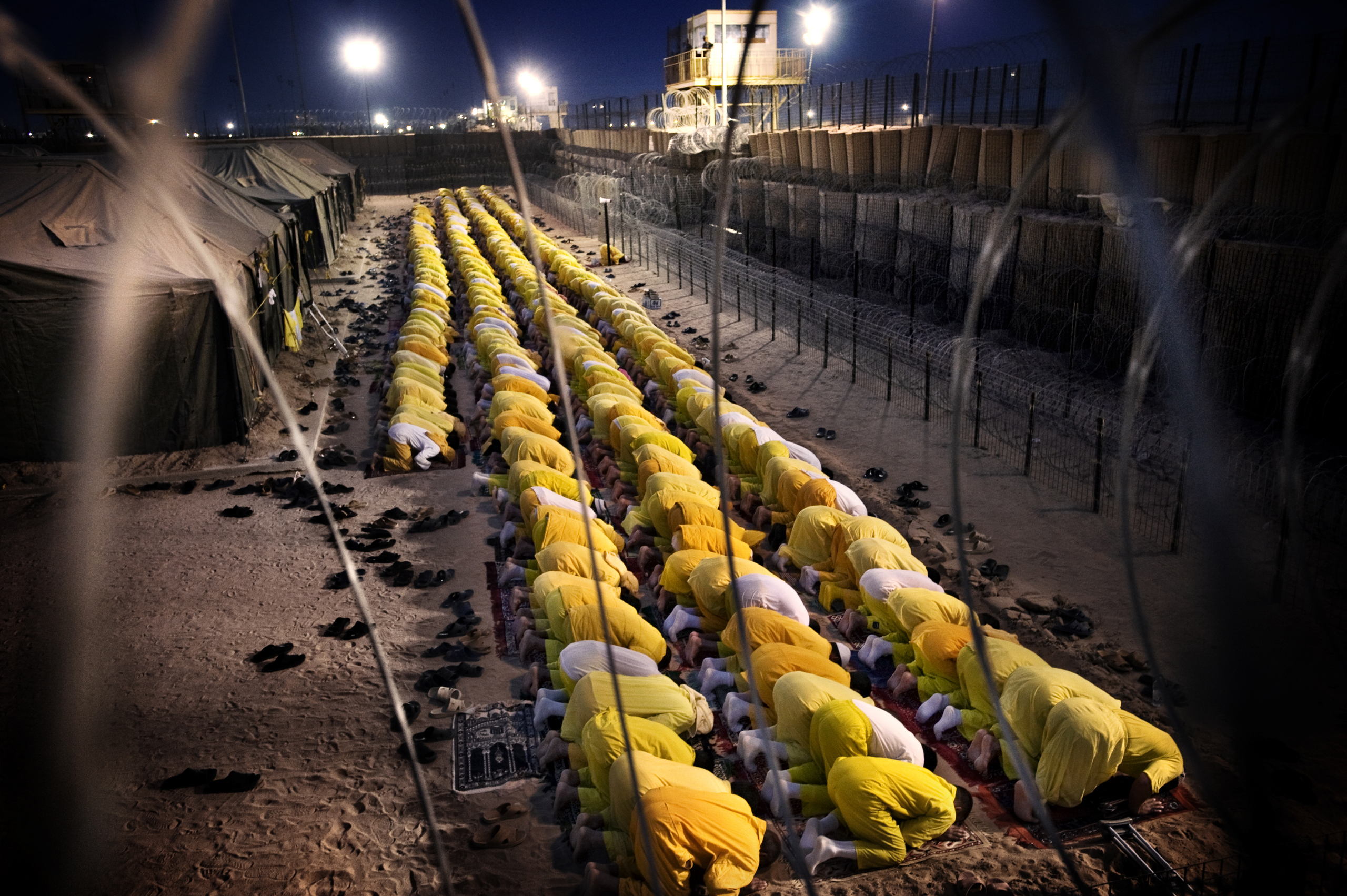 Detainees pray at U.S. military detention facility Camp Bucca, Iraq, March 16, 2009.