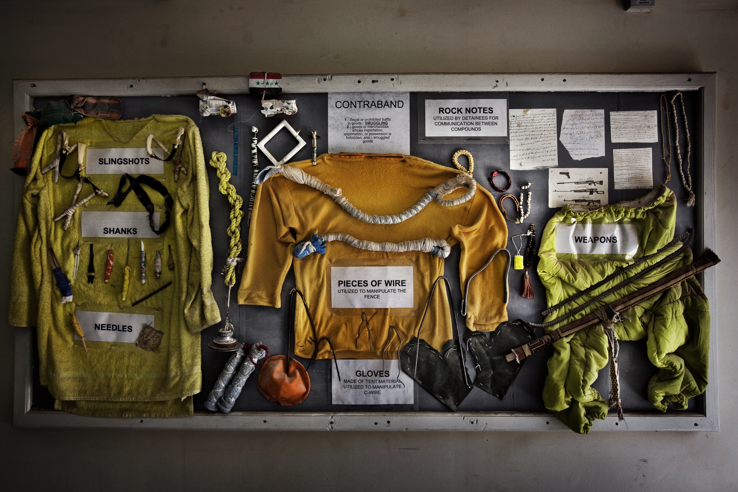 A bulletin board at Camp Cropper, the second-largest U.S. military detention facility in Iraq, displaying makeshift weapons and other contraband confiscated from the Iraqi detainees, Baghdad, Iraq, July 26, 2008.