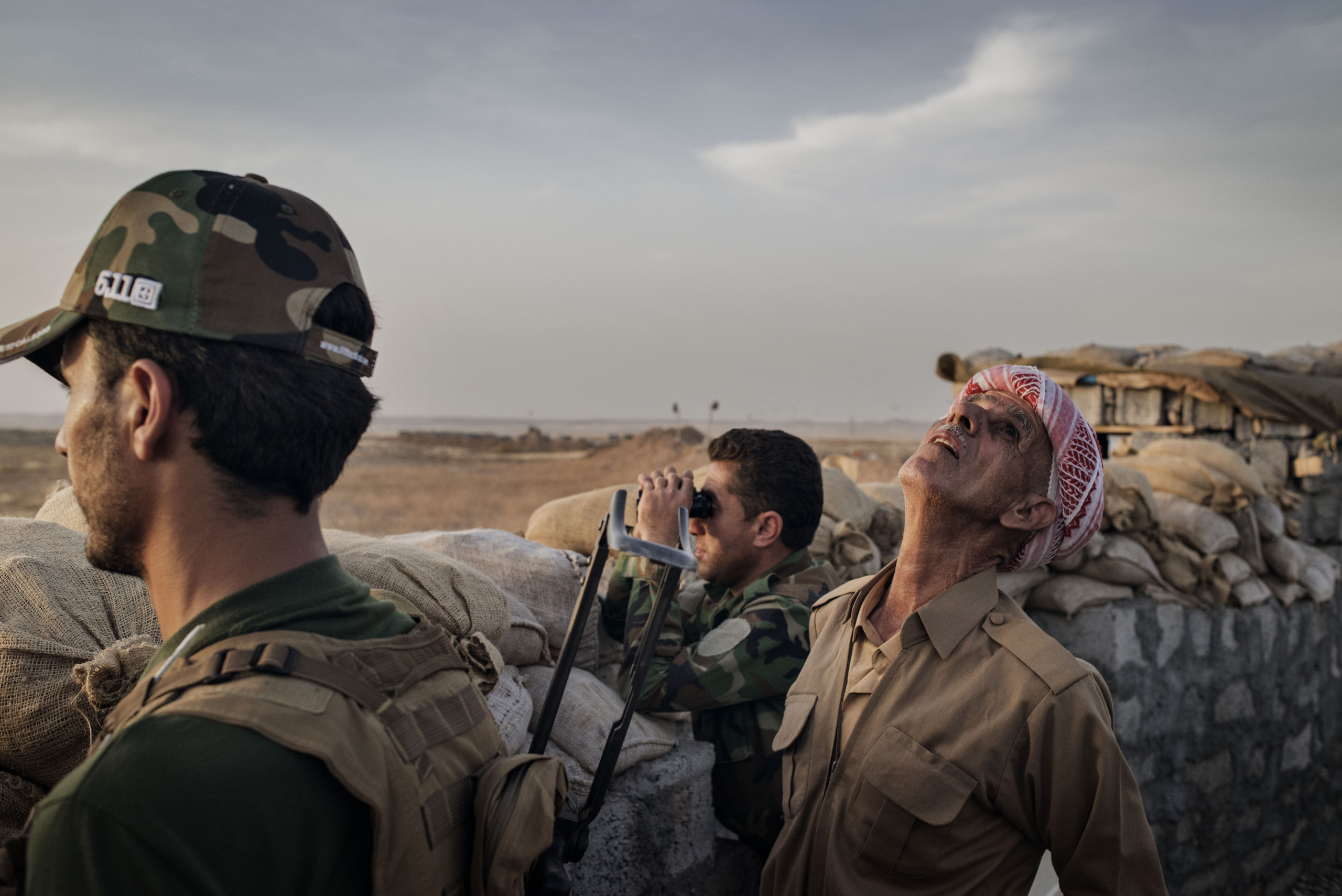 Kurdish Peshmerga forces defend their front line position against ISIS fighters in the northern Iraqi village of Sultan Abdullah, May 15, 2016.