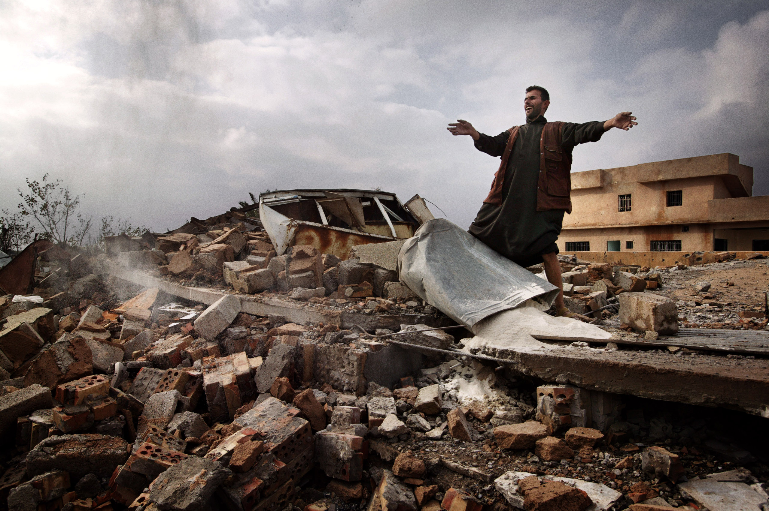 Laith Klabos stands on the ruins of his home in Boasil village across the Tigris from Tikrit. The house was demolished by American soldiers, November 2003.