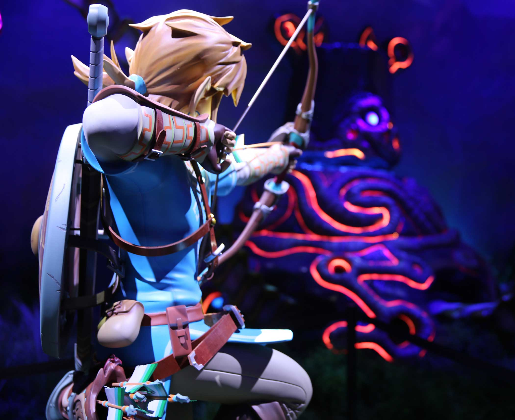 Over-the-shoulder view of Link taking aim at a foe.