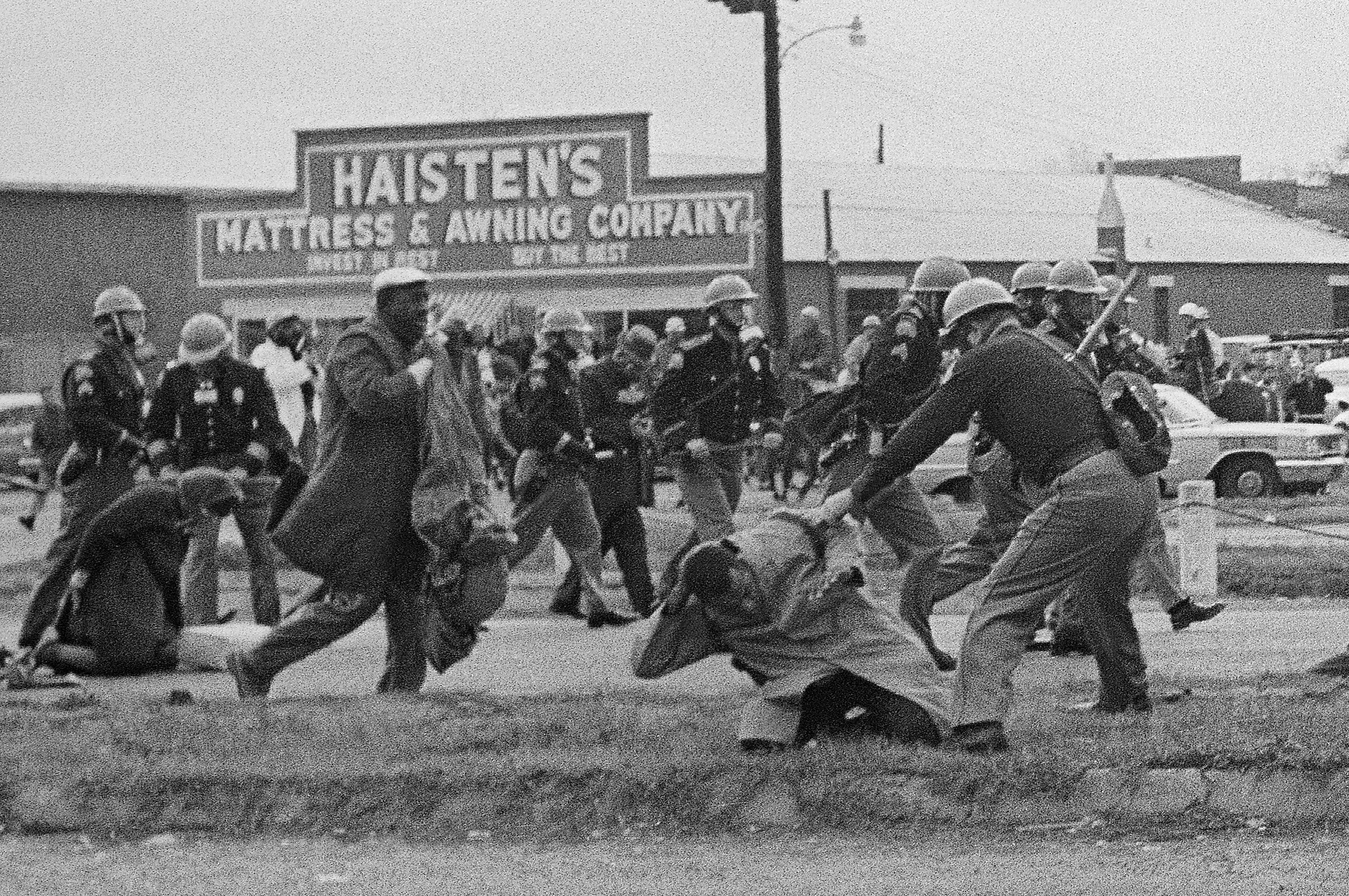 State troopers swing billy clubs to break up a civil rights voting march in Selma, Alabama., March 7, 1965. John Lewis, chairman of the Student Nonviolent Coordinating Committee (in the foreground) is being beaten by a state trooper.