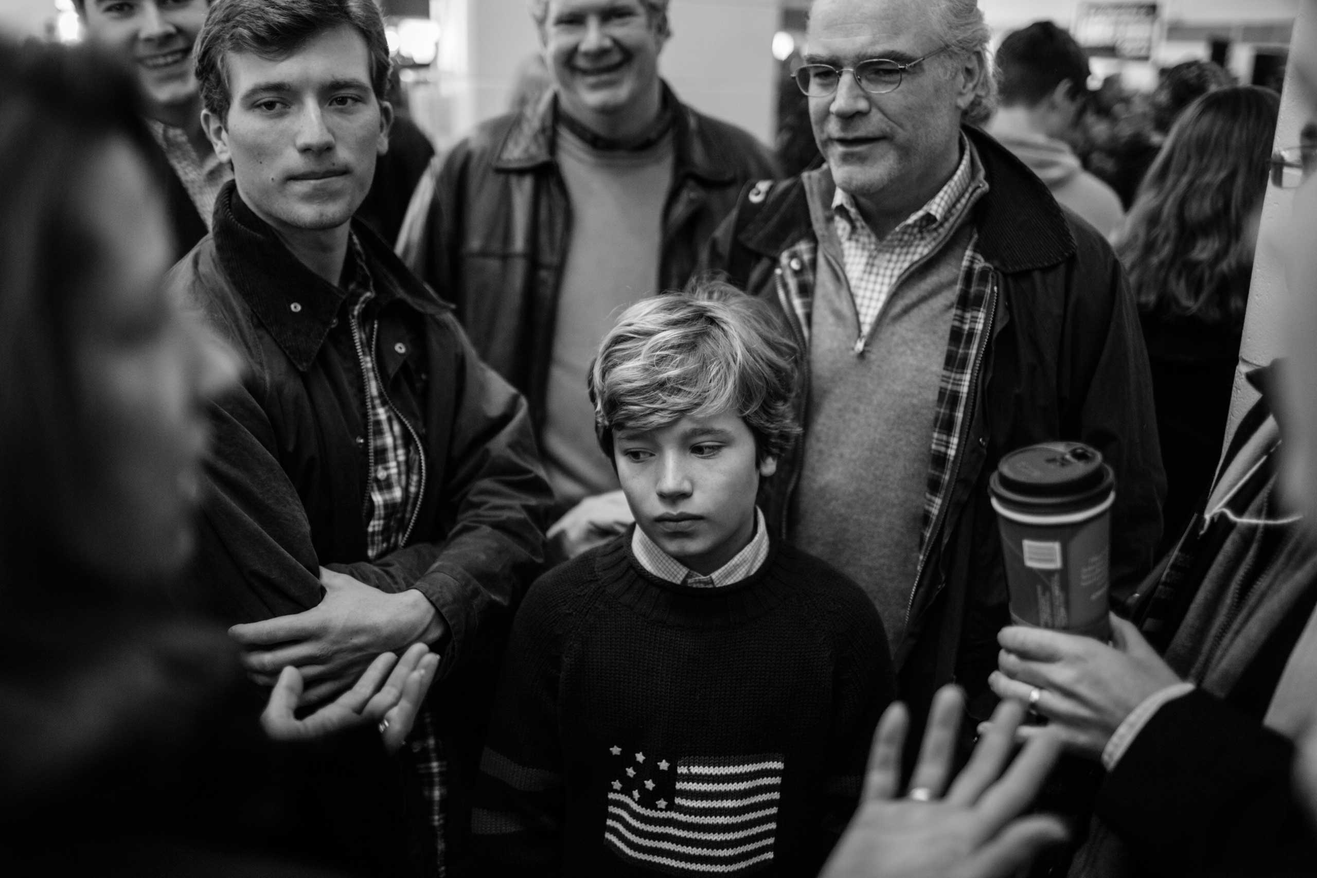 February 7, 2016 - Londonderry, New Hampshire: A boy stands encircled by his family at a Marco Rubio Pancake event.