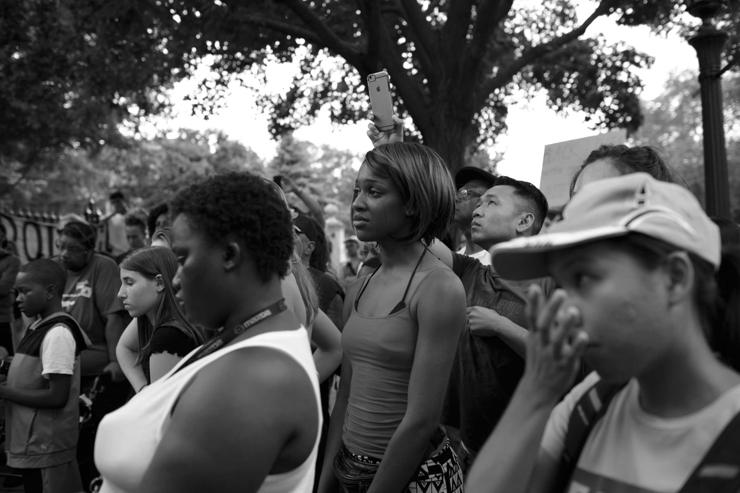 July 7, 2016 - St. Paul, Minnesota: Destiny Jackson (center) is attending a protest as a reaction to the fatal shooting of Philando Castile a day before. Black Lives Matters activists and people from the community gathered to grieve and demonstrate in front of the Governors mansion. Castile was shot by a police officer in Falcon Heights after his car was pulled over.