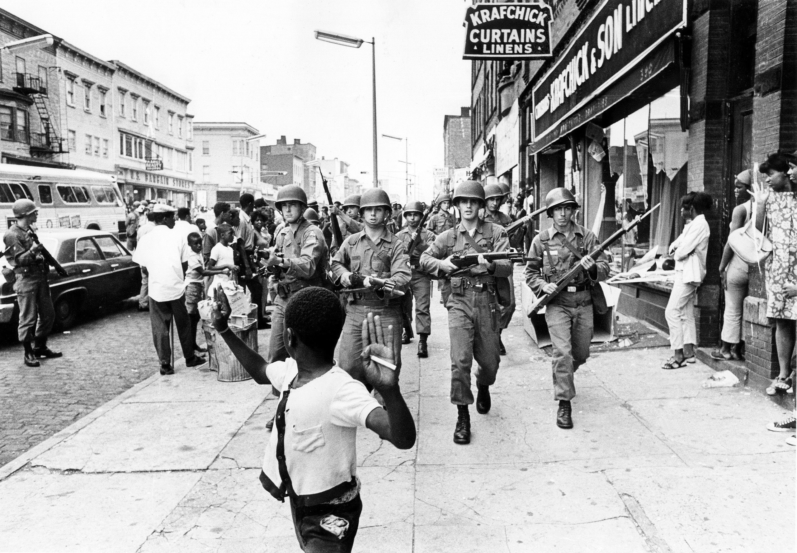 Members of the National Guard on Springfield Avenue in Newark, N.J.  clearing the street on July 14, 1967, after rioting took place.  Their rifles had unsheathed bayonets fixed to the barrels.