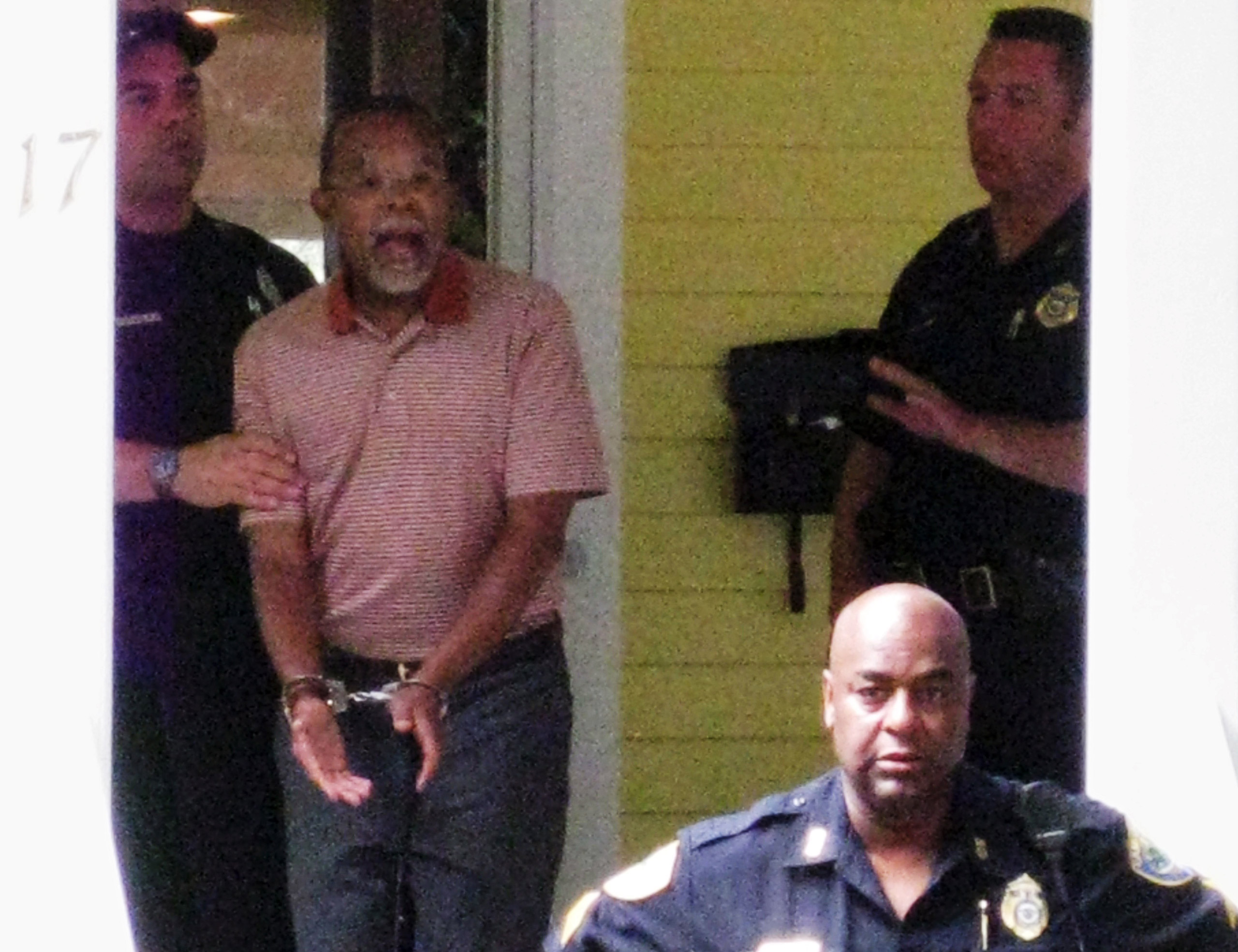 Henry Louis Gates Jr. center, the director of Harvard University's W.E.B. DuBois Institute for African and African American Research, is arrested at his home in Cambridge, Mass. on July 16, 2009.