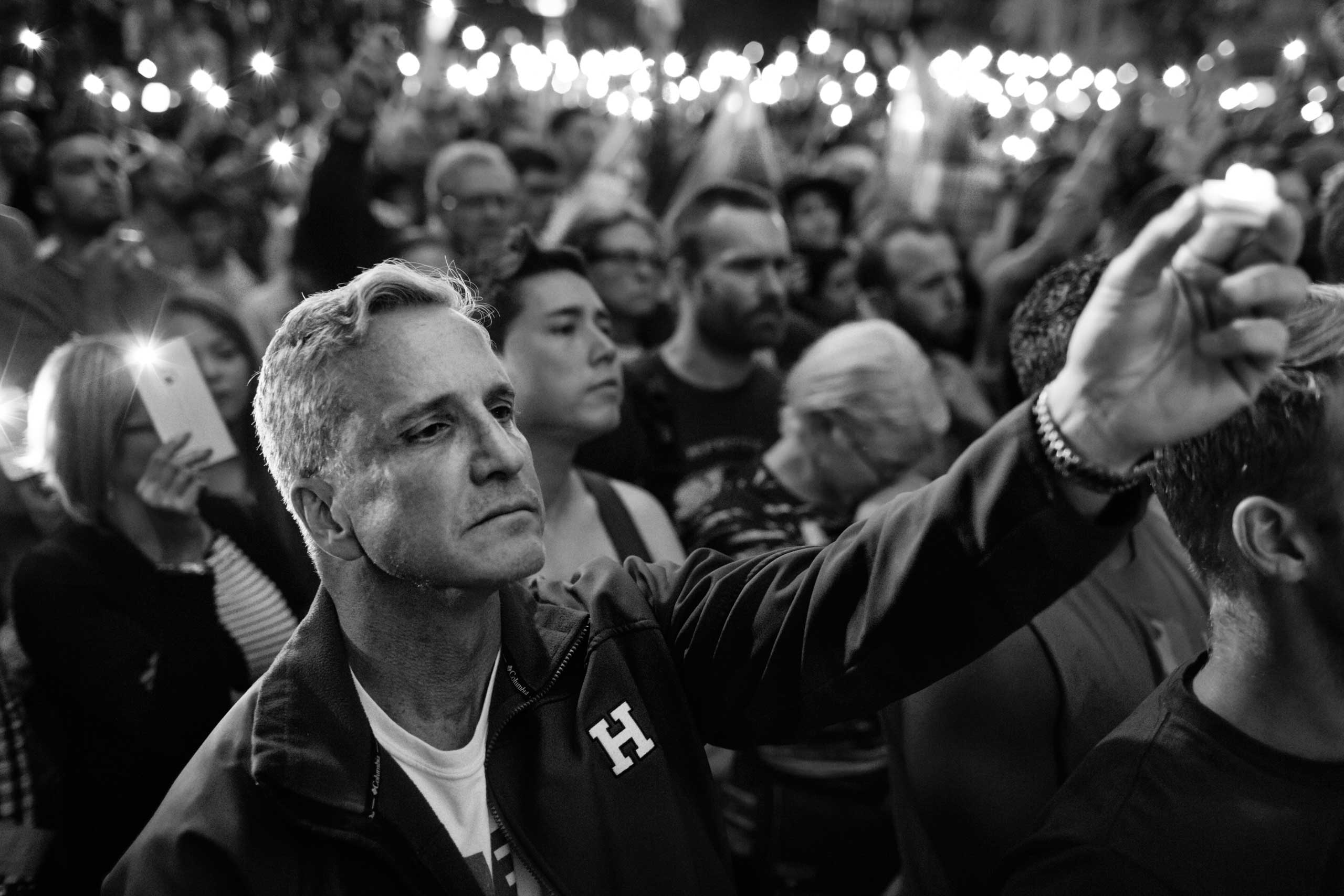 June 13, 2016 - New York, New York: Jeff Davis is holding up a candle at a vigil for the victims of the Orlando shooting at Stonewall Inn.