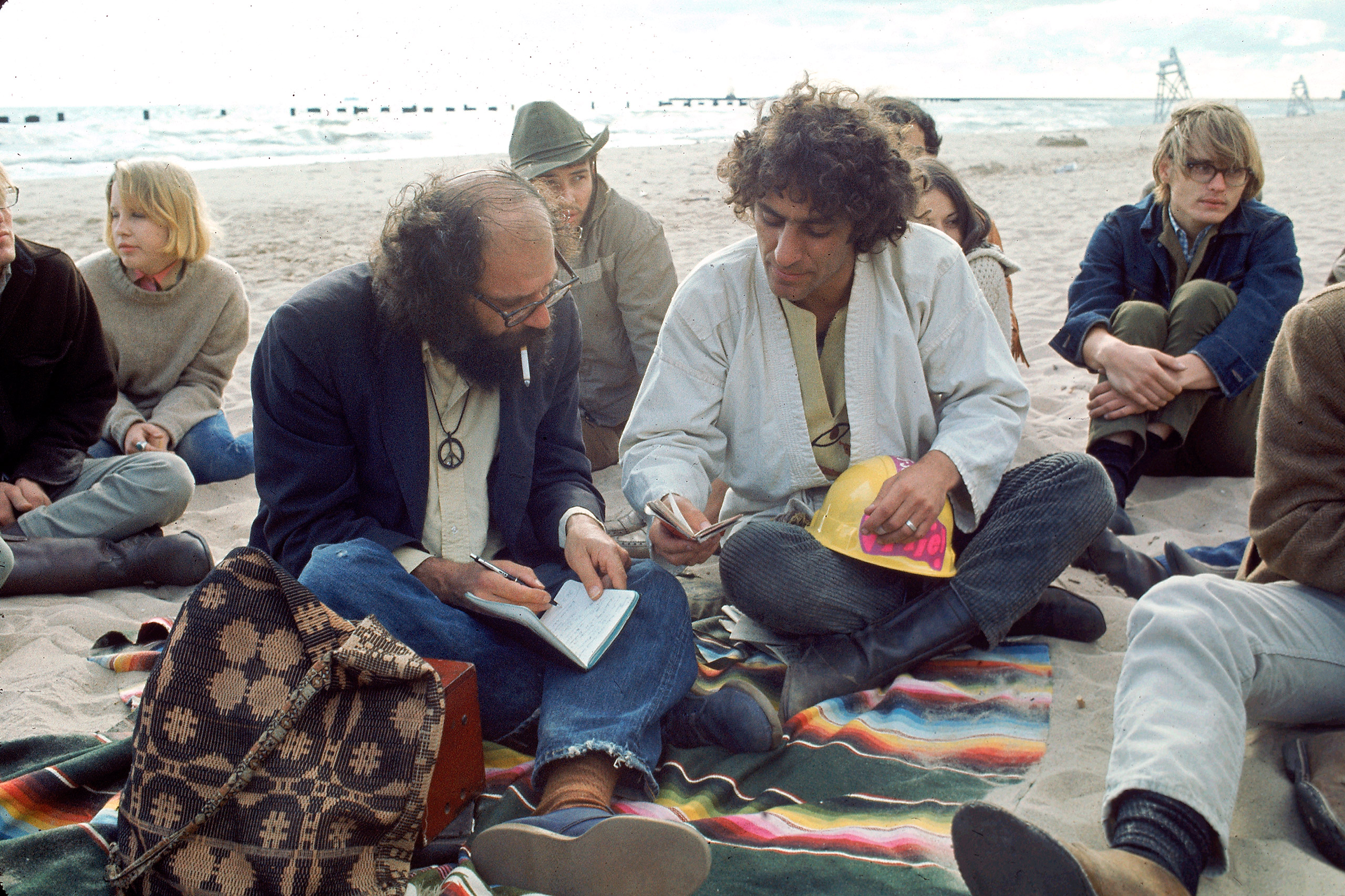 Poet Allen Ginsberg (L) comparing notes with yippie activist Abbie Hoffman during the 1968 Democratic National Convention.