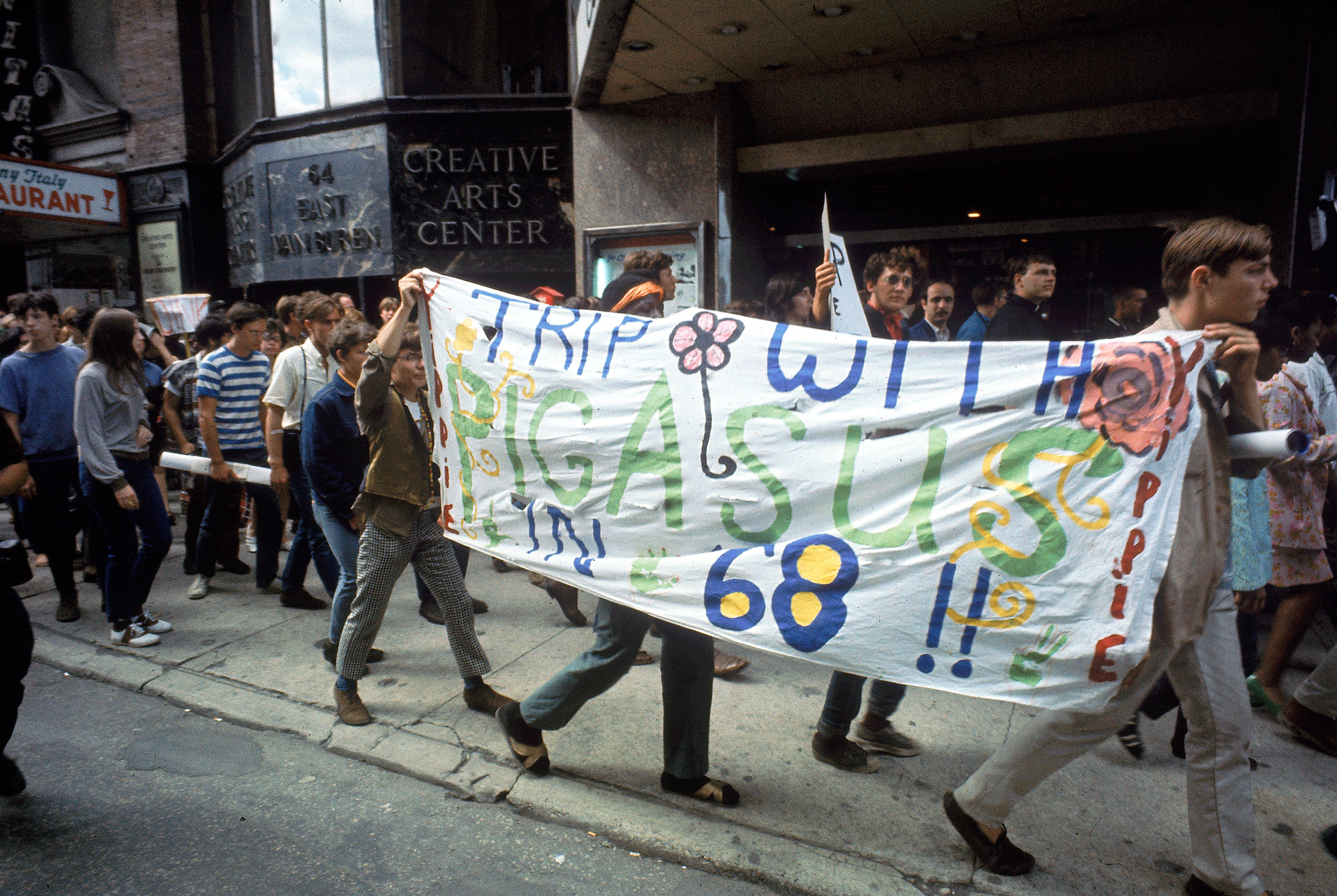 Yippie protesters carrying banner with name of their Presidential  candidate  Pigasus during the 1968 Democratic National Convention.