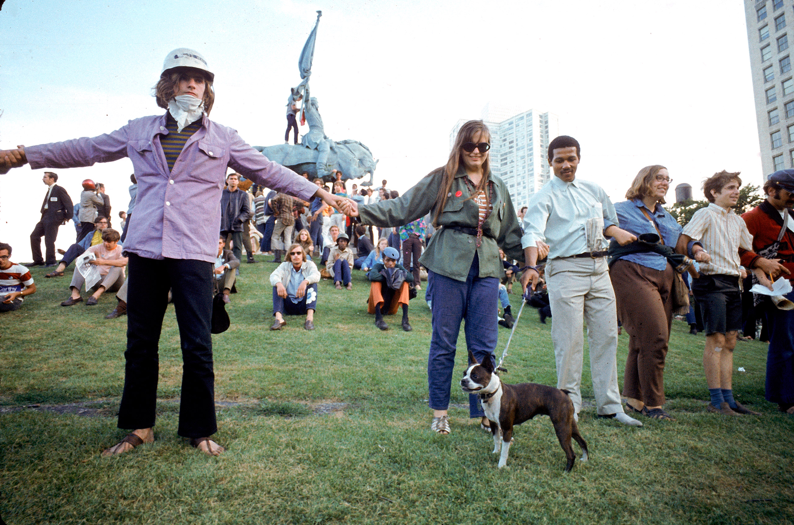 Yippie protesters linking arms in Grant Park demonstration during the 1968 Democratic National Convention.