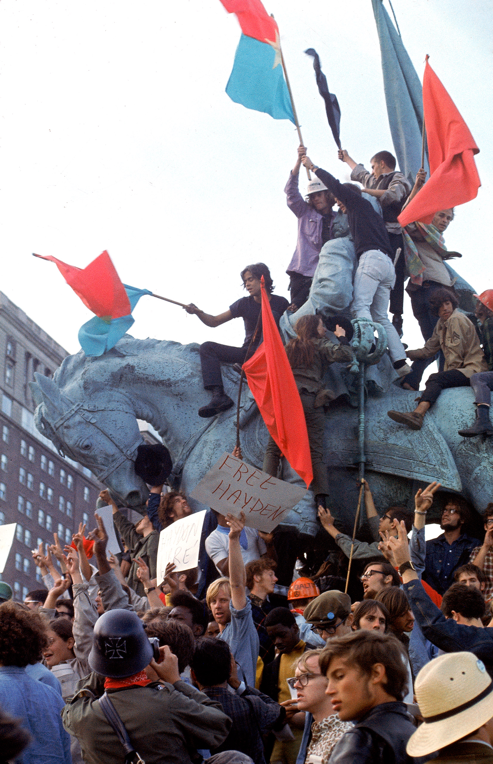 Caption from TIME. In the most dramatic of the convention's protests, Yippies stormed an equestrian monument in Grant Park to protest the arrest of one of their leaders.