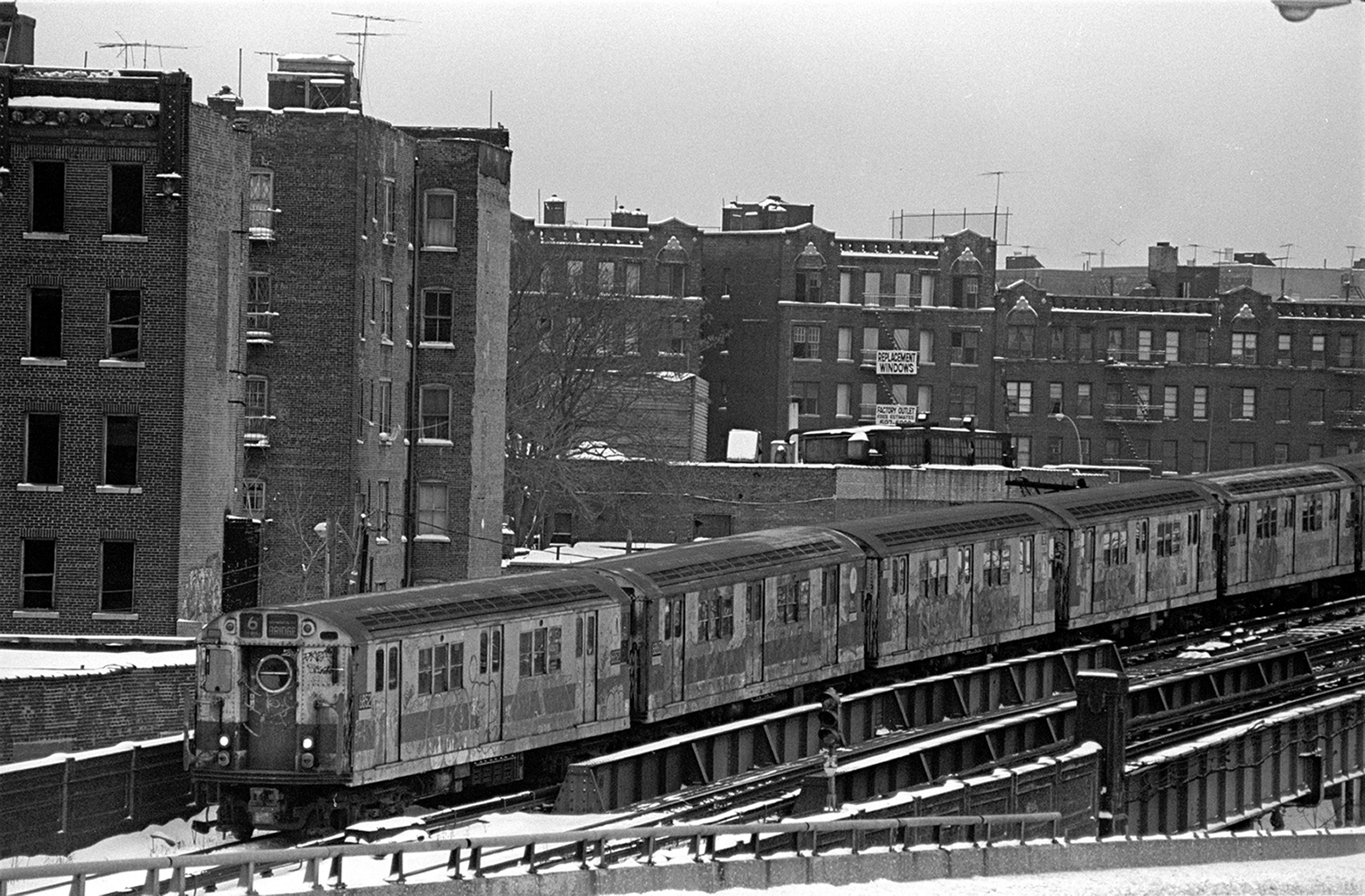 View of the number 6 local subway train as it passes through the South Bronx neighborhood, New York, New York, 1975.
