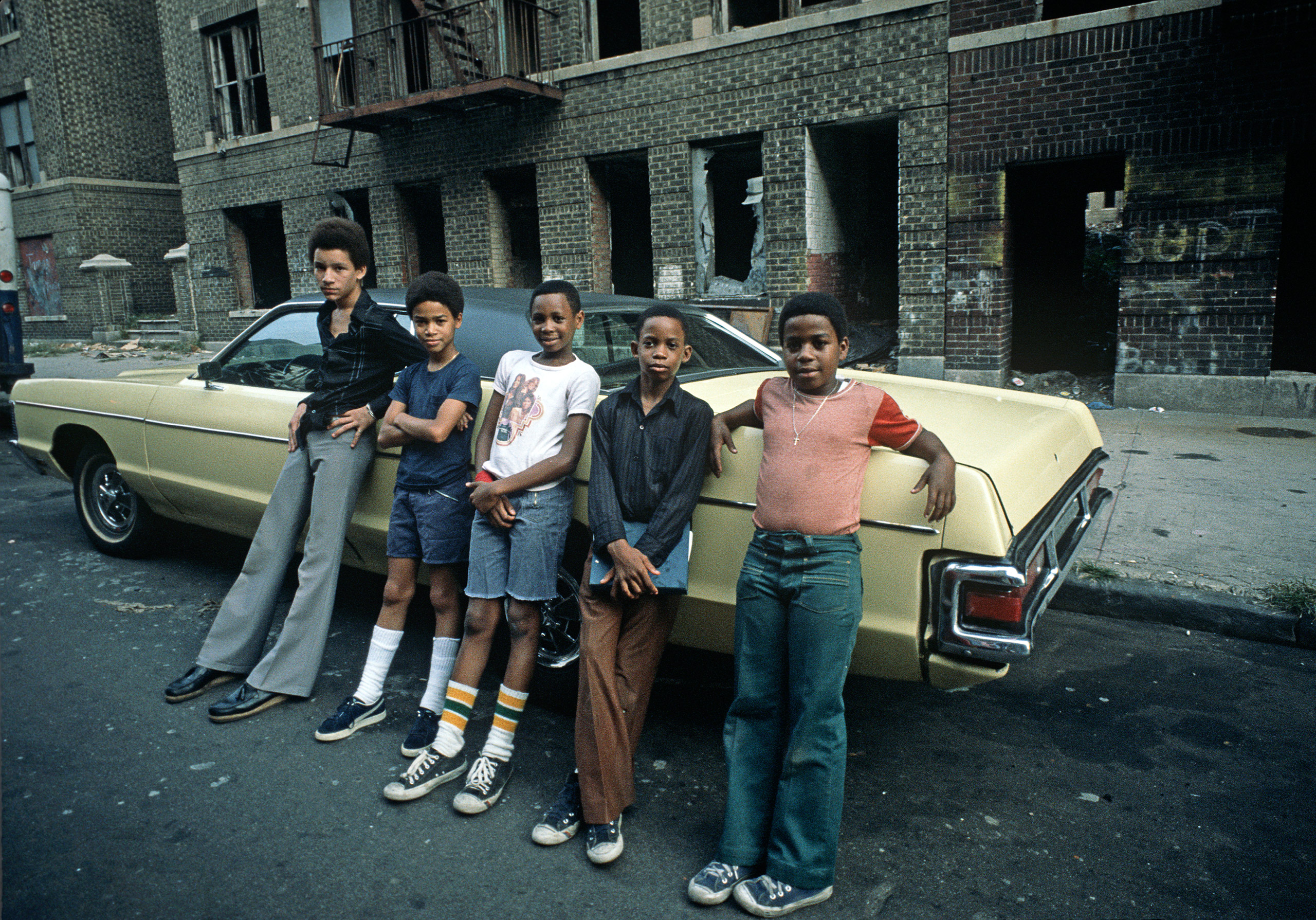 South Bronx teenagers in front of abandoned tenement burnt-out buildings, South Bronx, New York, August 1977.