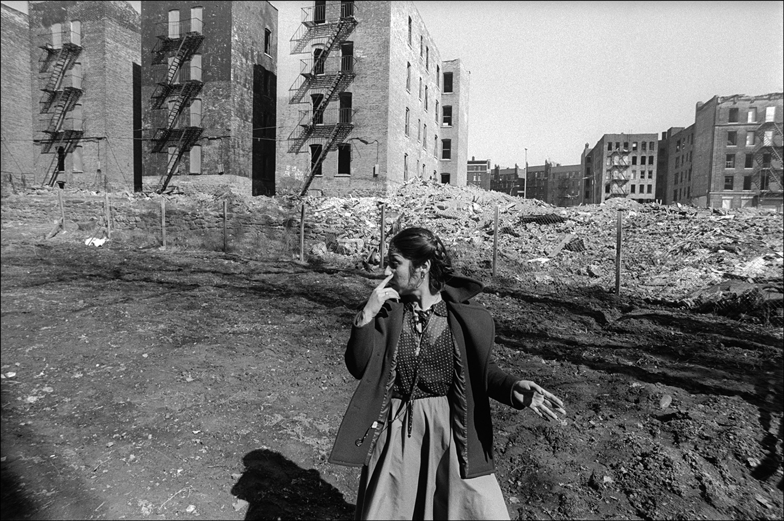 A woman walks among abandoned buildings in the South Bronx, New York, March 1979.