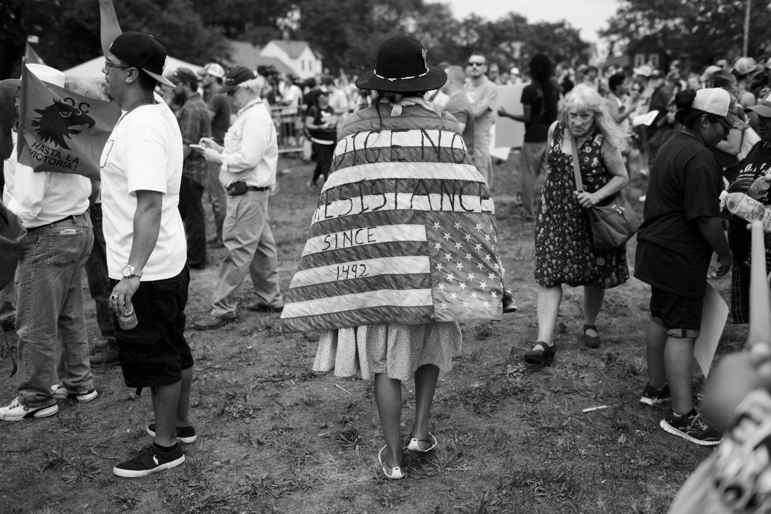 July 18, 2016 - Cleveland, Ohio: Kim Smith, a Native American woman from Dine Nation, AZ, is walking through a crowd at the  End Poverty  rally on the first day of the Republican National Convention in East Cleveland.