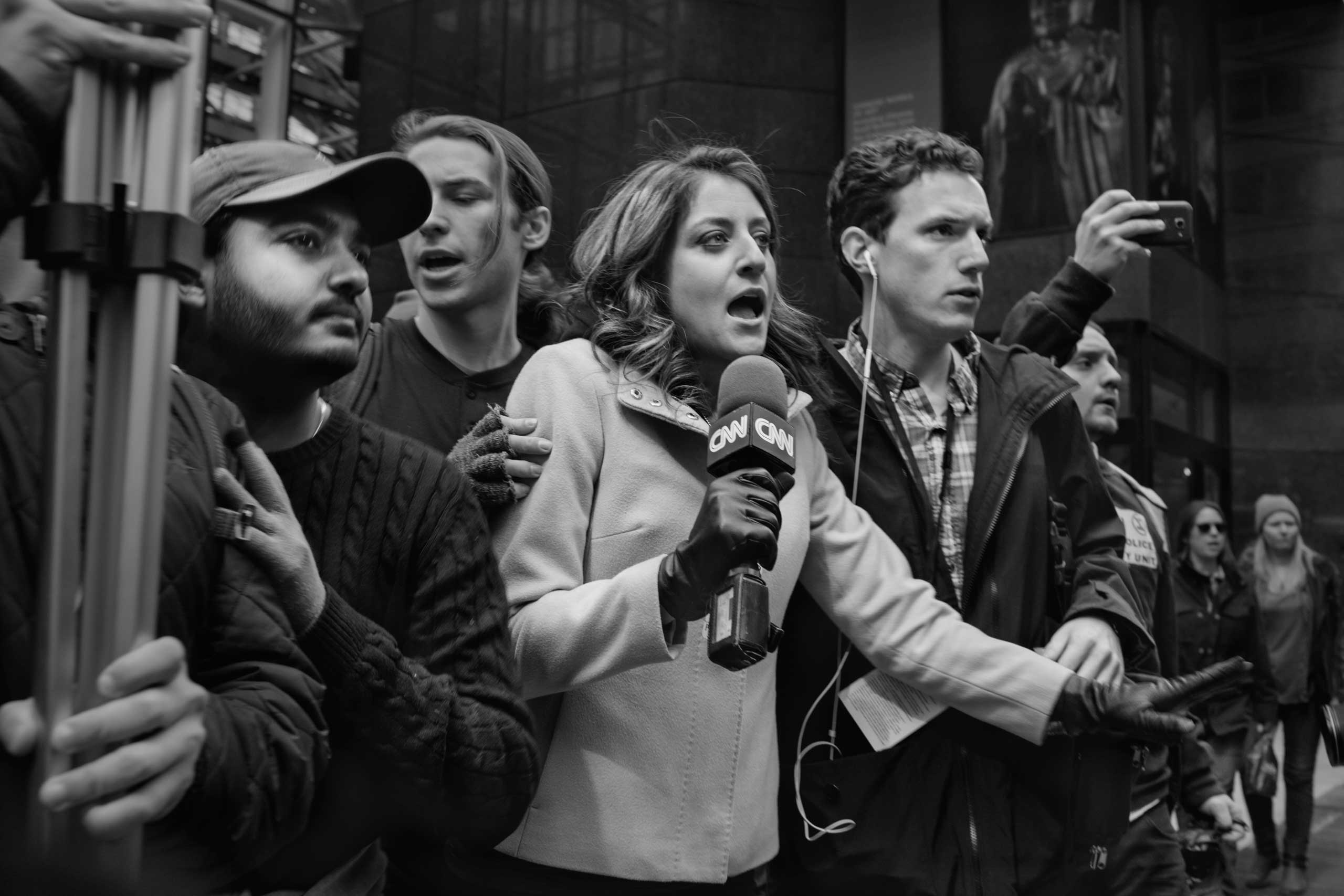 March 19, 2016 - New York, New York: CNN correspondent Sara Ganim (center) observes the arrest of a person by the NYPD after a small skirmish at a rally against republican candidate Donald J. Trump in Midtown.