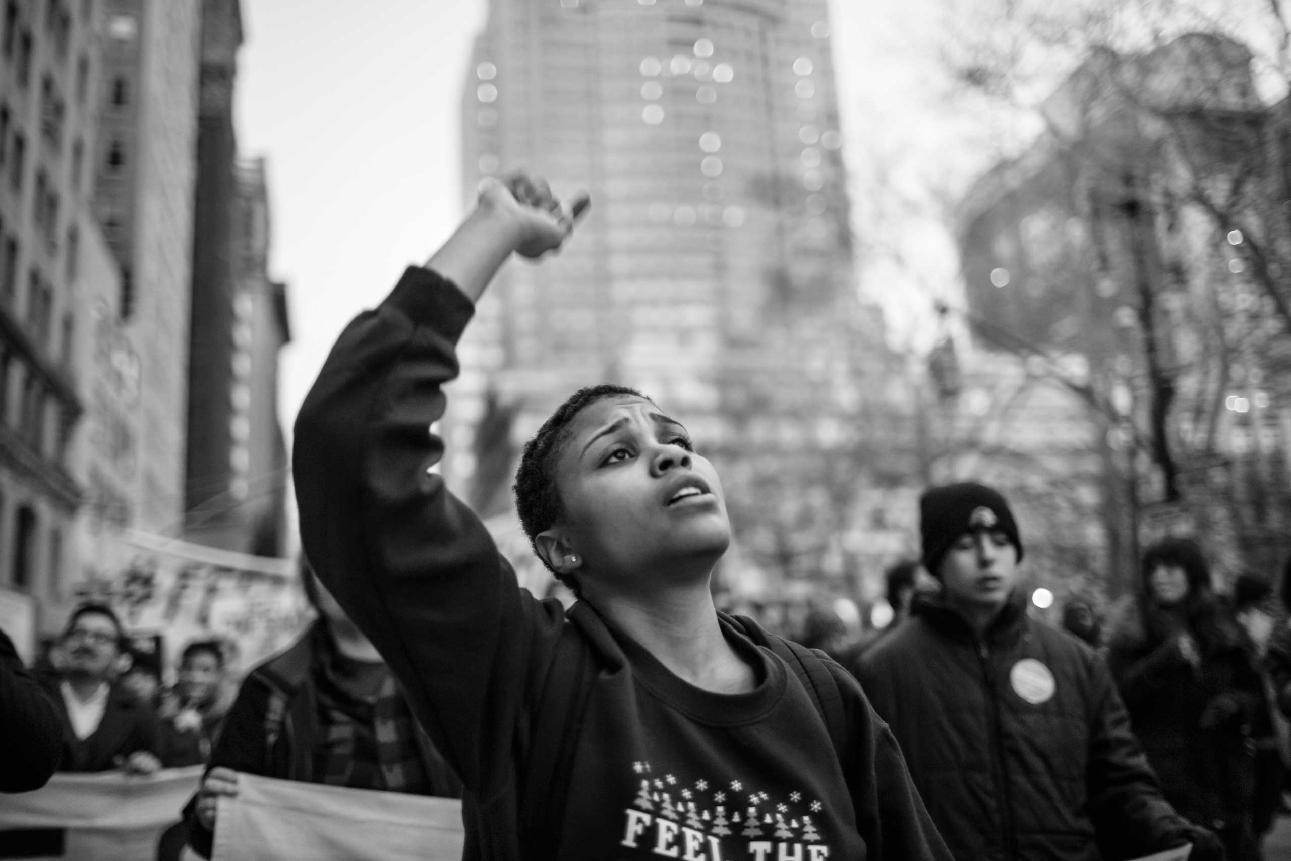 January 30, 2016 - New York, New York: A supporter is rallying for Democratic Party presidential candidate Bernie Sanders on a march from Union Square to Zuccotti Park.
