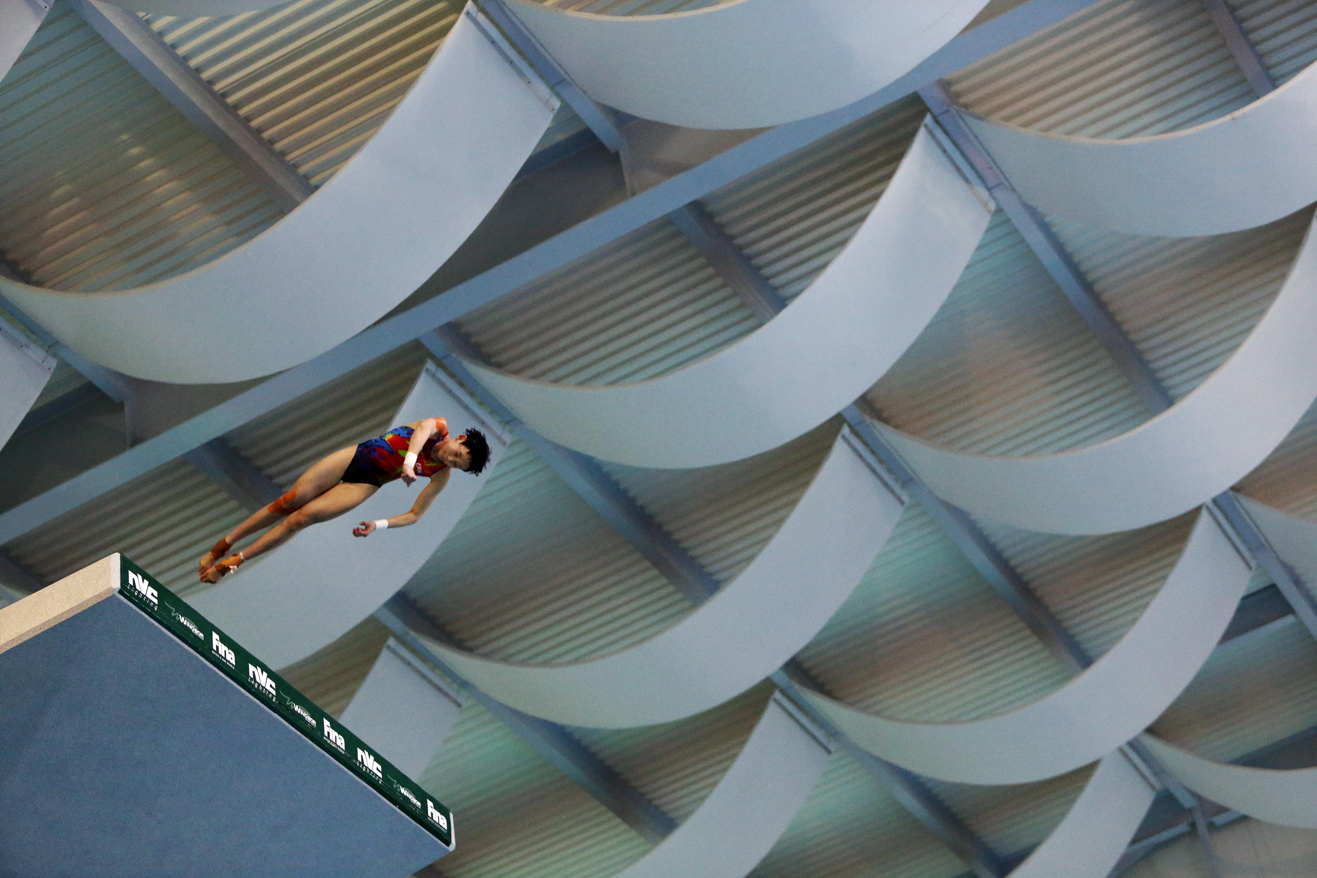 """<strong>Ren Qian, Diving, China</strong>On Feb. 21, one day after turning 15, Ren Qian walked to the edge of a platform in Rio de Janeiro and plunged the equivalent of a three-story building. Delivering a back 21-2 somersault and a half twist, the young diver slid into the pool with barely a ripple. The judges awarded Ren a perfect 10, cementing her victory in the 10-m platform diving World Cup event and establishing her as the latest in a line of Chinese diving prodigies cultivated by the state. """"They must start between the ages of 3 to 4,"""" says Yu Lianming, who has coached top divers for decades in China's vast network of state-run sports schools.                                   When Ren returns to Brazil in August, she'll be the prohibitive favorite in the high dive—and a critical part of a 13--person Chinese squad that has the talent to sweep the Olympic diving golds. (China won all but two in London in 2012.) In a sport in which American women are no threat to medal, the crop-haired athlete's toughest competition comes from her compatriots. —H.B."""