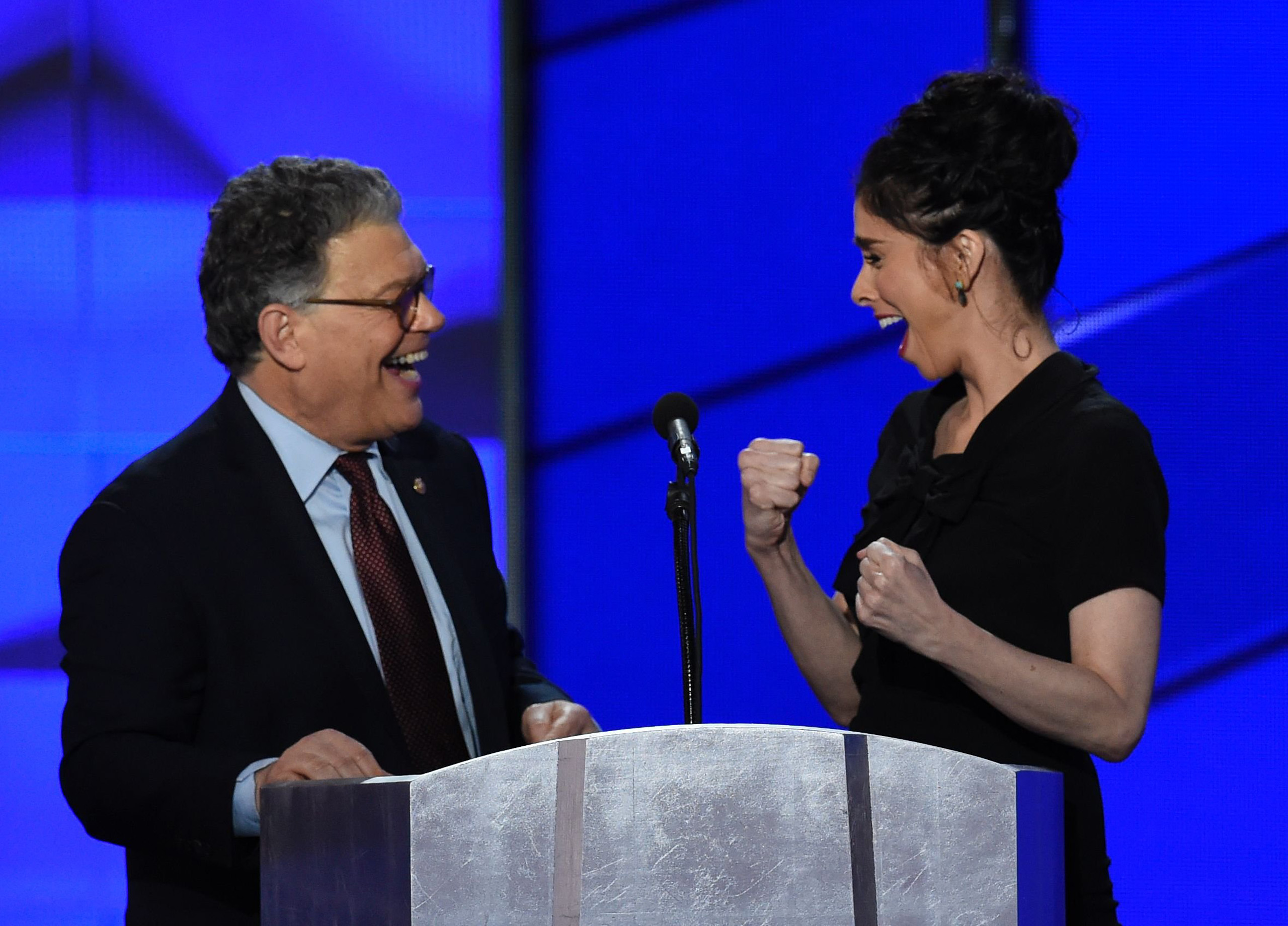 US Senator Al Franken (L) and comedian Sarah Silverman share a moment during Day 1 of the Democratic National Convention at the Wells Fargo Center in Philadelphia on July 25, 2016.