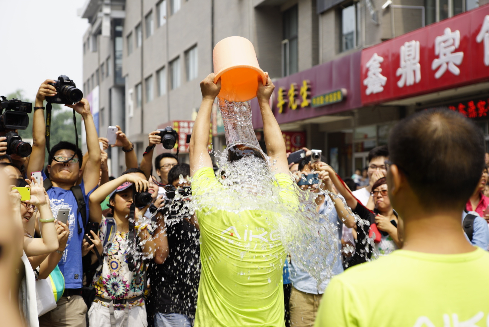 A group of people participate in the ALS Ice Bucket Challenge at  on August 21, 2014 in Beijing, China.