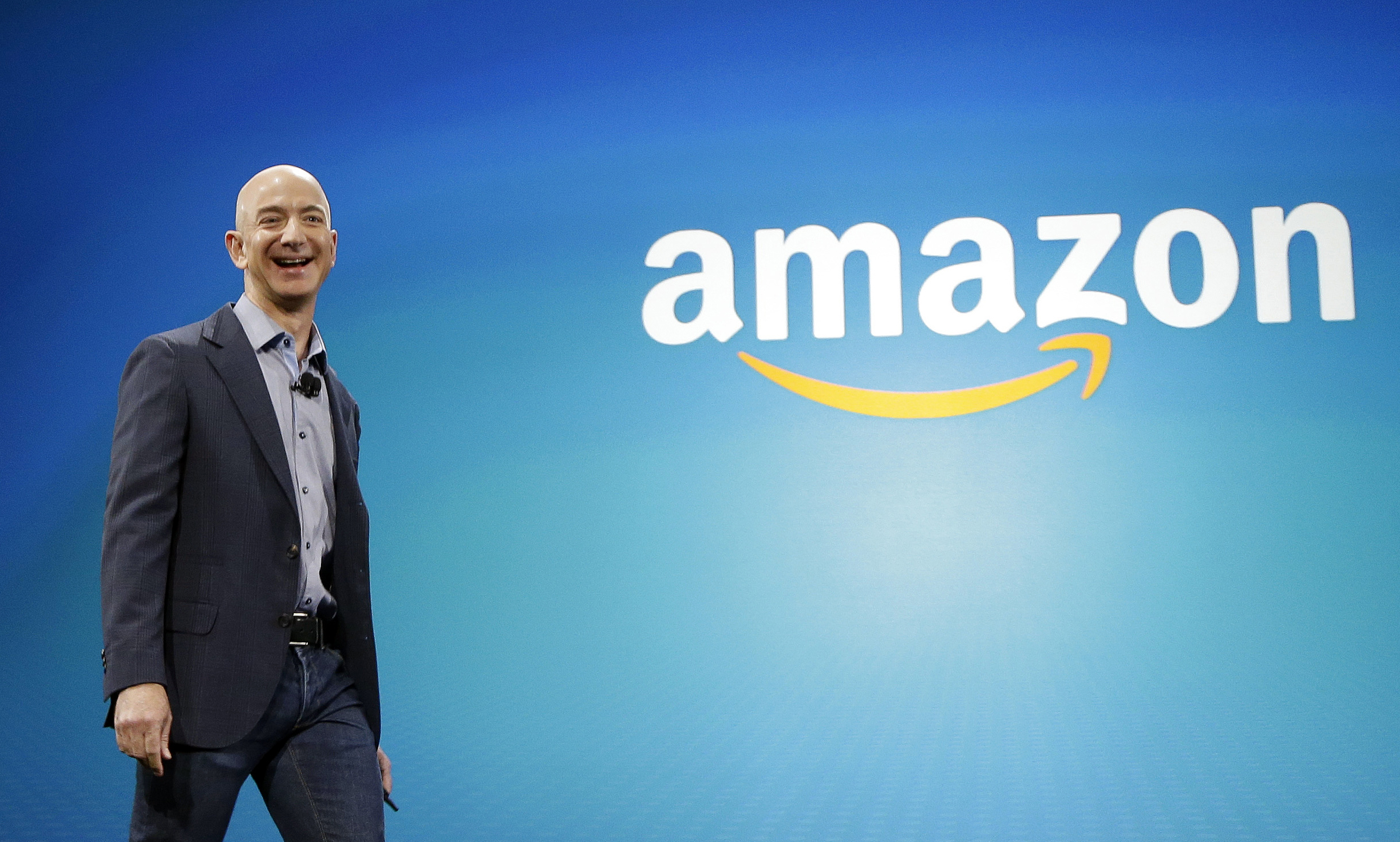 Amazon CEO Jeff Bezos walks onstage for the launch of the new Amazon Fire Phone in Seattle on June 16, 2014.