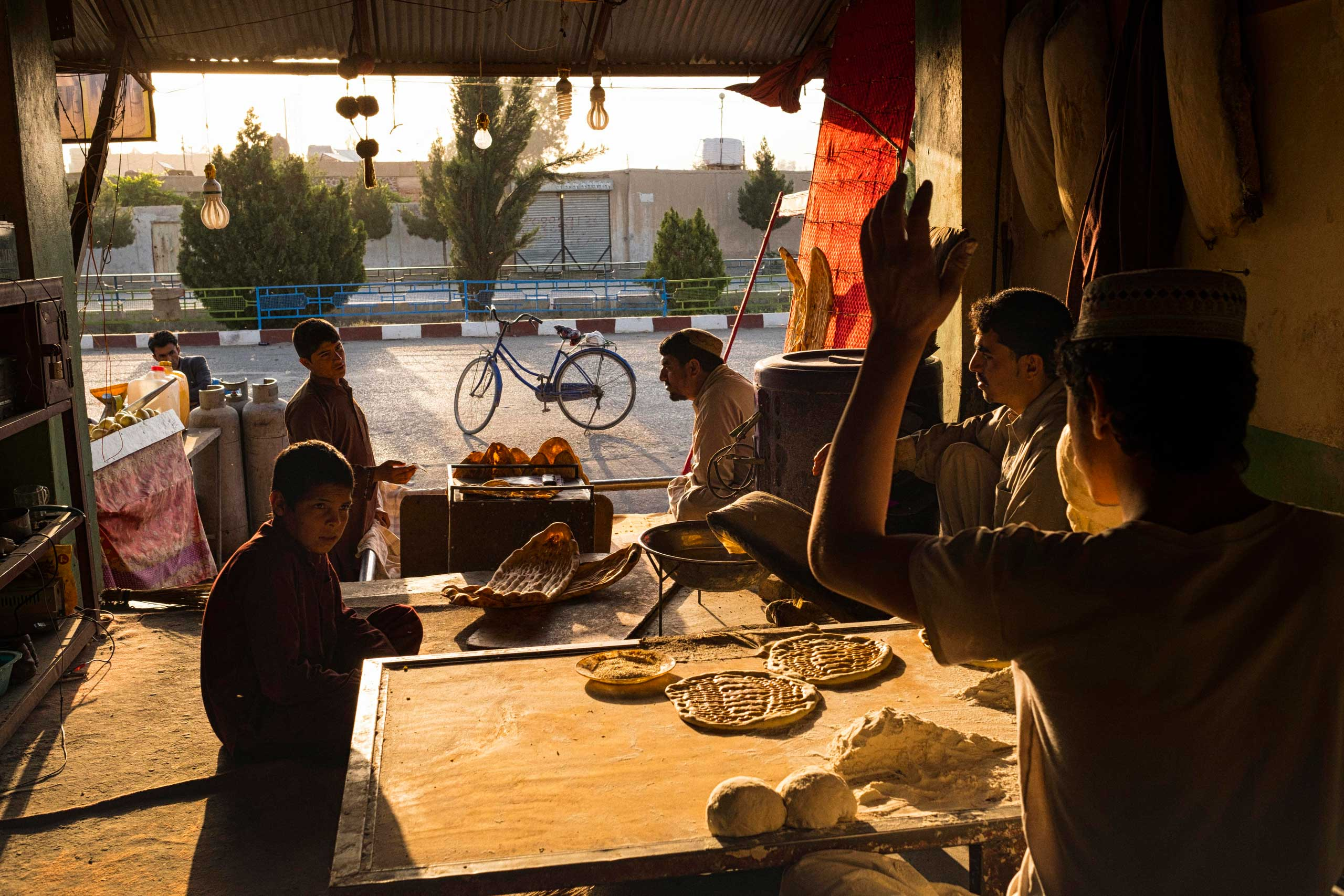 Bakers at work in at sunrise in Lashkar Gah, the capital of Helmand Province in southern Afghanistan during a period of relative calm as the region's vast poppy crop is harvested.