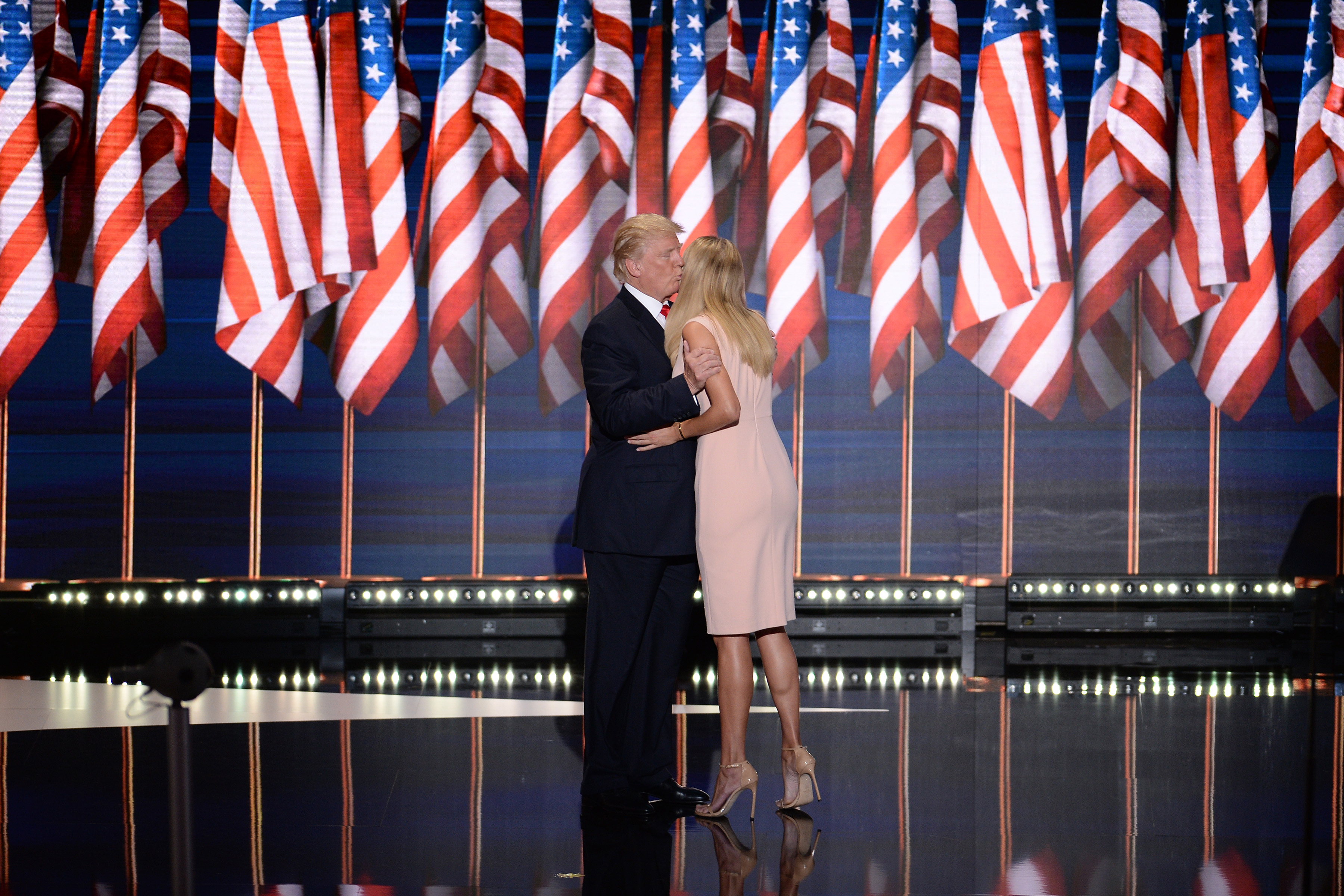 Republican presidential candidate Donald kisses his daughter Ivanka Trump before he addresses delegates on the fourth and final day of the Republican National Convention at the Quicken Loans Arena in Cleveland, OH, on July 21, 2016