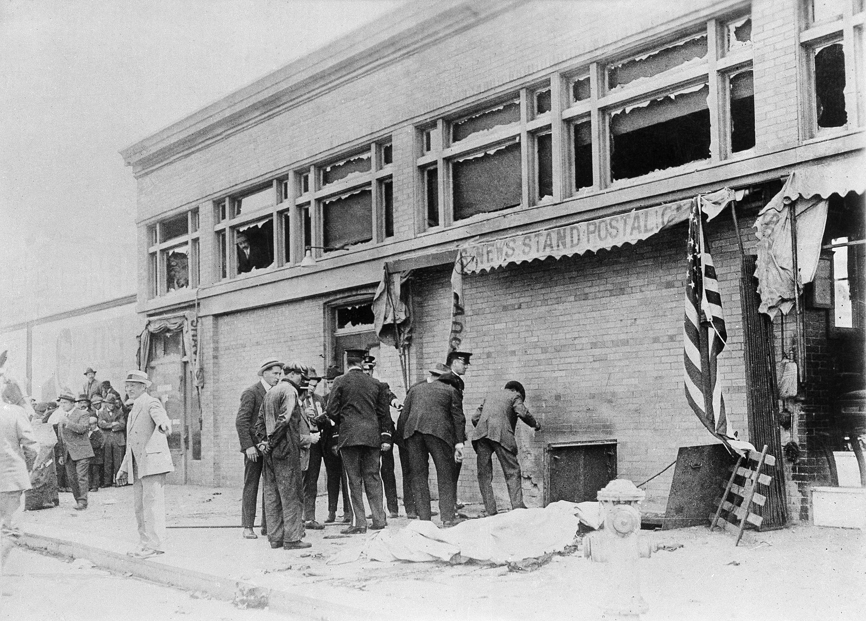 Police and officials inspect the area where a bomb exploded during the Preparedness Day parade in San Francisco, Calif., July 22, 1916.