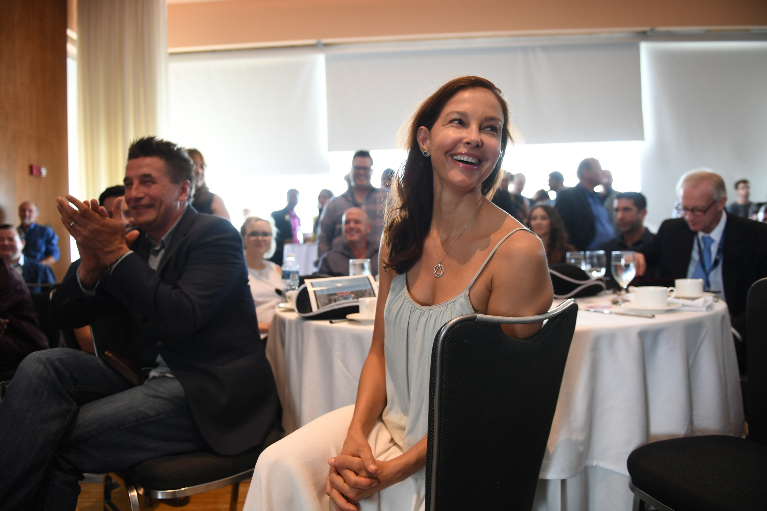 Actress Ashley Judd, a member of The Creative Coalition, greets people at a DC statehood and voting rights luncheon at the Loews Philadelphia Hotel during the second day of the Democratic National Convention in Philadelphia on July 26, 2016.
