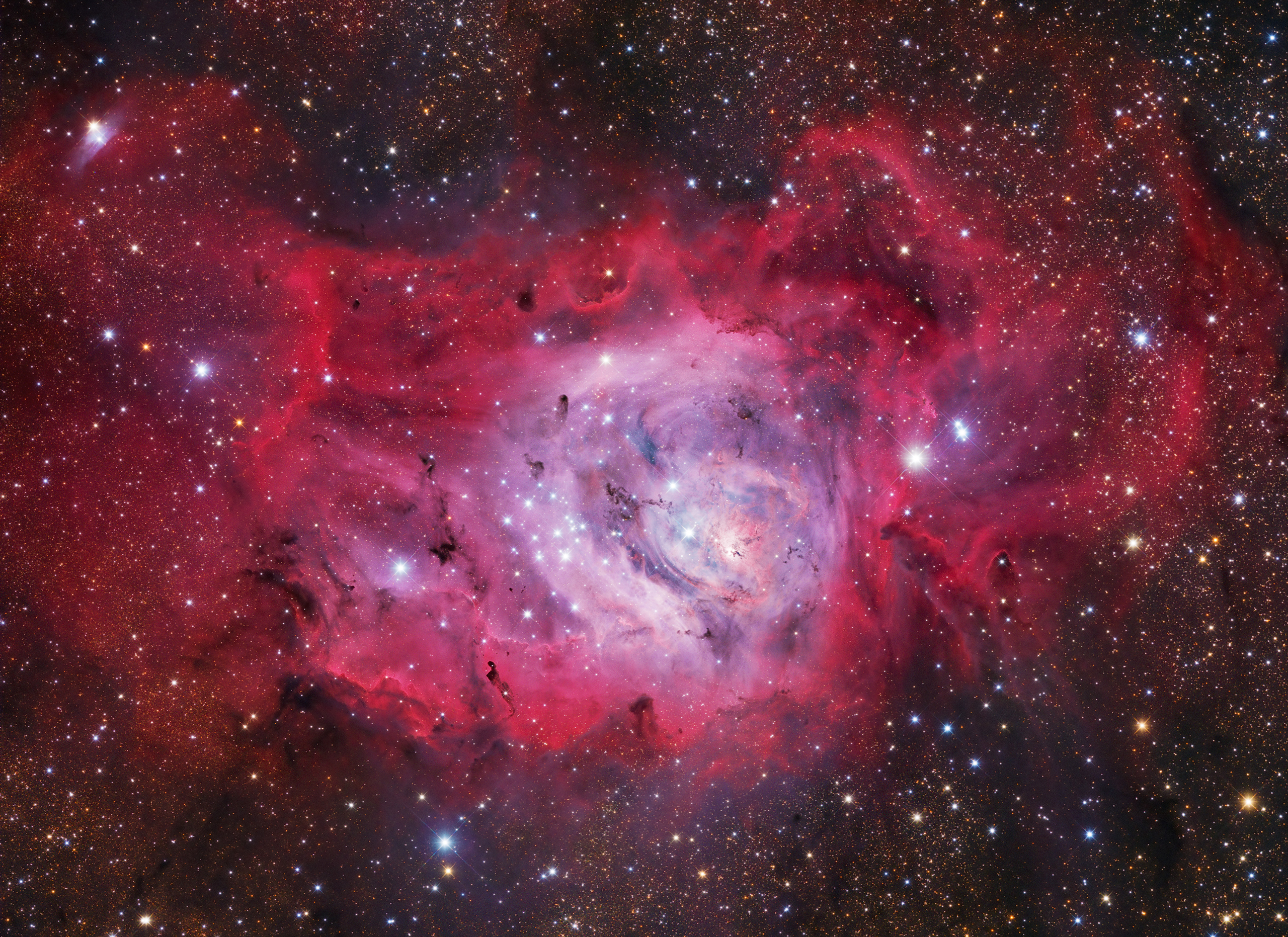 New stars are formed in the undulating clouds of M8, also commonly referred to as the Lagoon Nebula, situated some 5,000 light years from our planet.