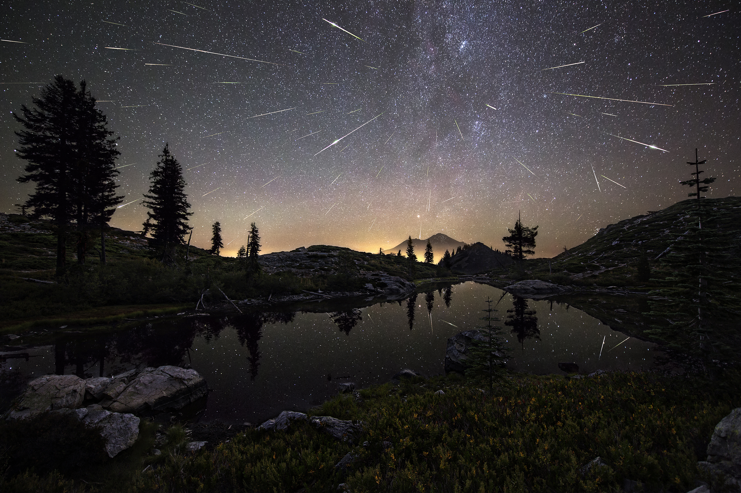 The Perseid Meteor Shower shoots across the sky in the early hours of Aug. 13, 2015, appearing to cascade from Mount Shasta in Calif., USA. The composite image features roughly 65 meteors captured by the photographer between 12:30am and 4:30am.