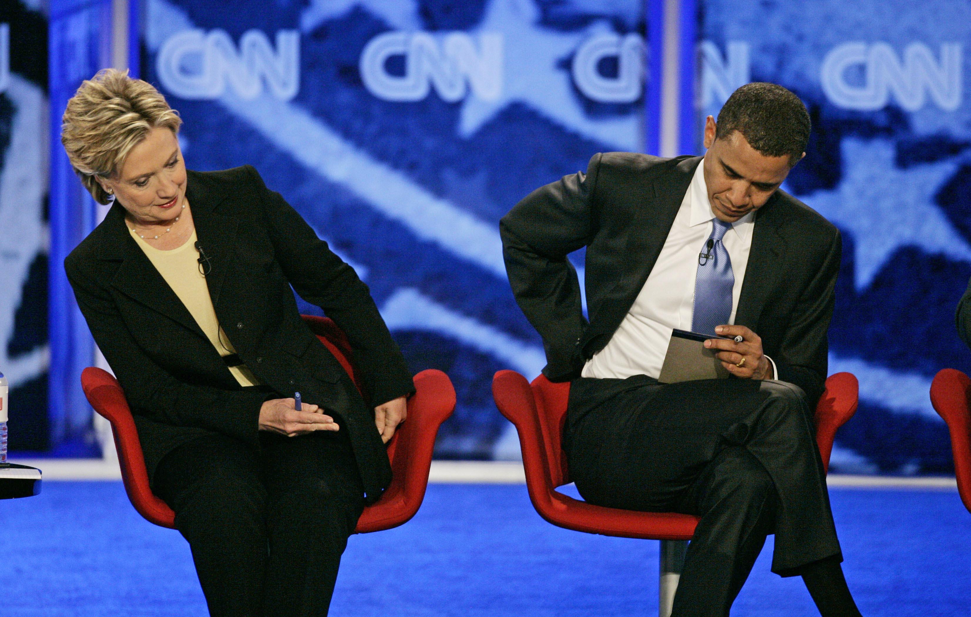 June 2007 Democratic presidential hopefuls Sen. Hillary Clinton, D-N.Y., left, and Sen. Barack Obama, D-Ill. adjust their seats at a Democratic presidential primary debate in Manchester, N.H. on June 3, 2007.