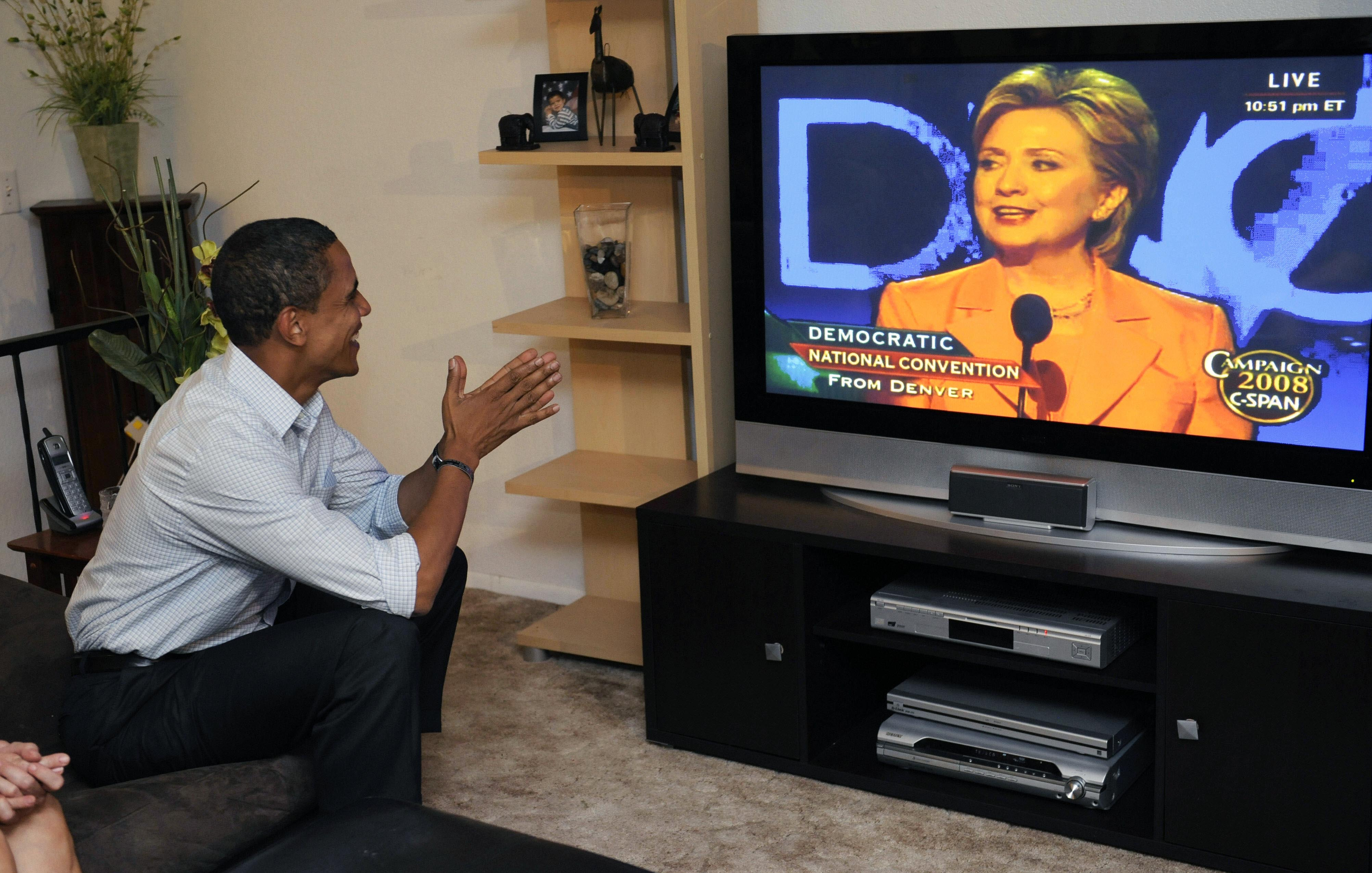 August 2008 Democratic presidential candidate Barack Obama watches a broadcast of Hillary Clinton addressing the Democratic National Convention from a television in Billings, Mt. on Aug. 26, 2008.