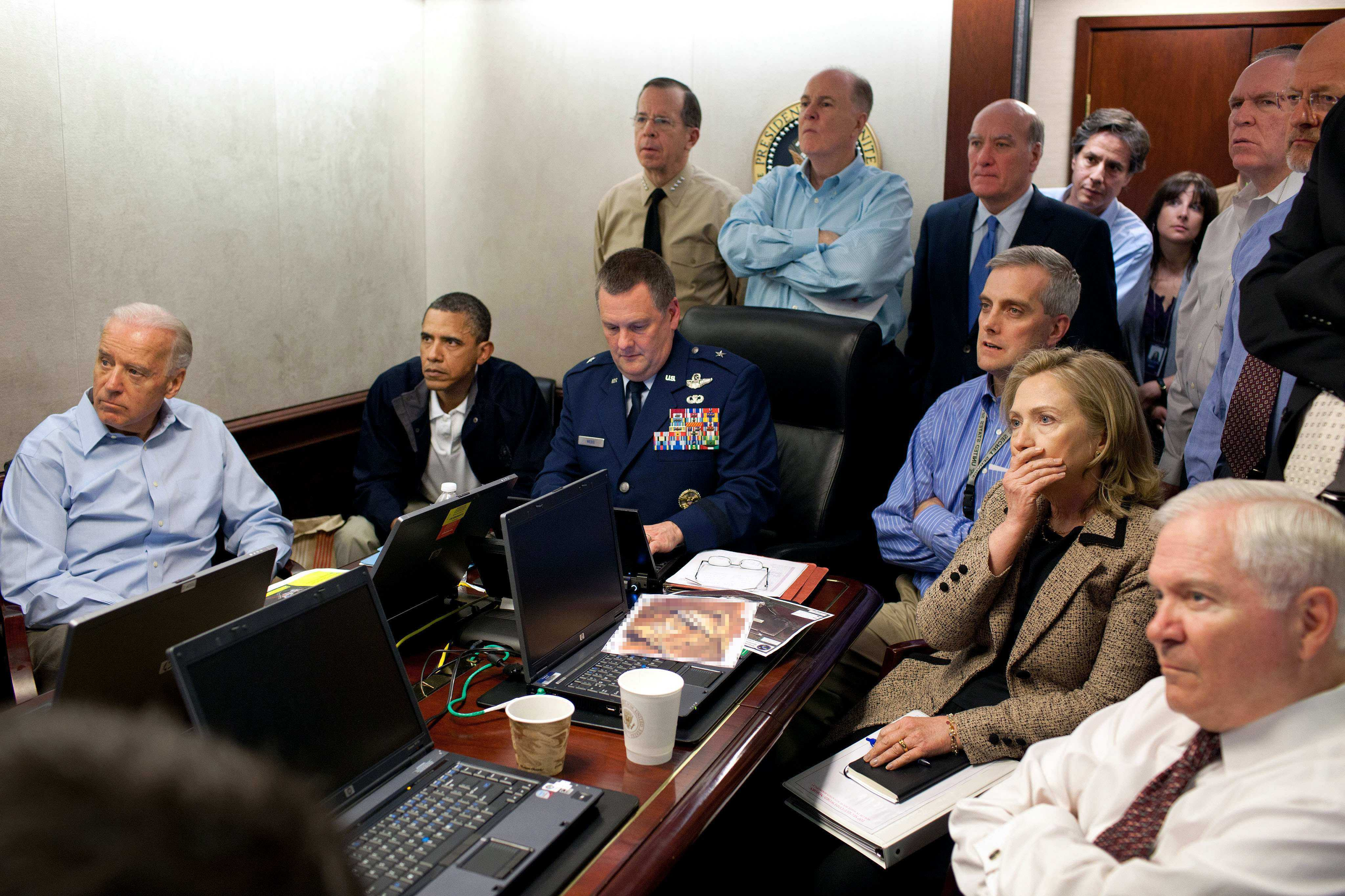 May 2011 In this photo released by the White House, Secretary of State Hillary Rodham Clinton, President Barack Obama and Vice President Joe Biden, along with with members of the national security team, receive an update on the mission against Osama bin Laden in the Situation Room of the White House in Washington on May 1, 2011.This photo WAS digitally altered by the White House to diffuse the information on the papers on the table.