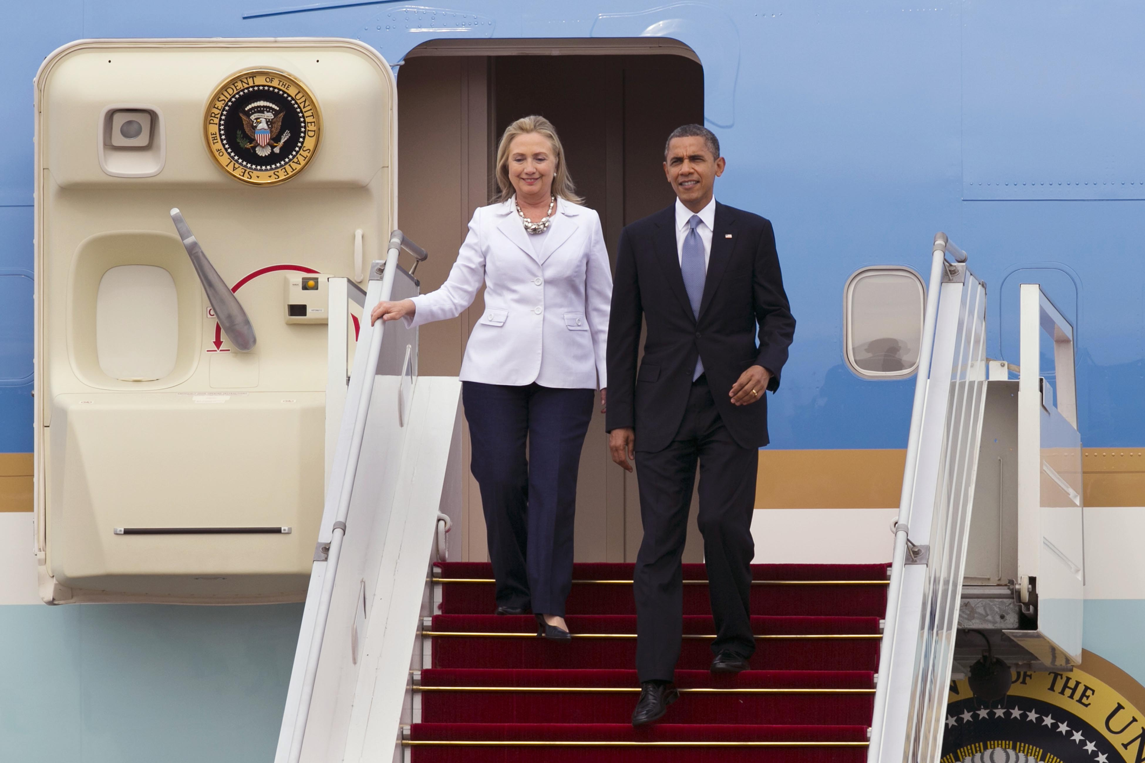 November 2012 President Barack Obama and then-Secretary of State Hillary Clinton arrive at Yangon International airport during his historical first visit to the country on Nov. 19, 2012 in Yangon, Myanmar.