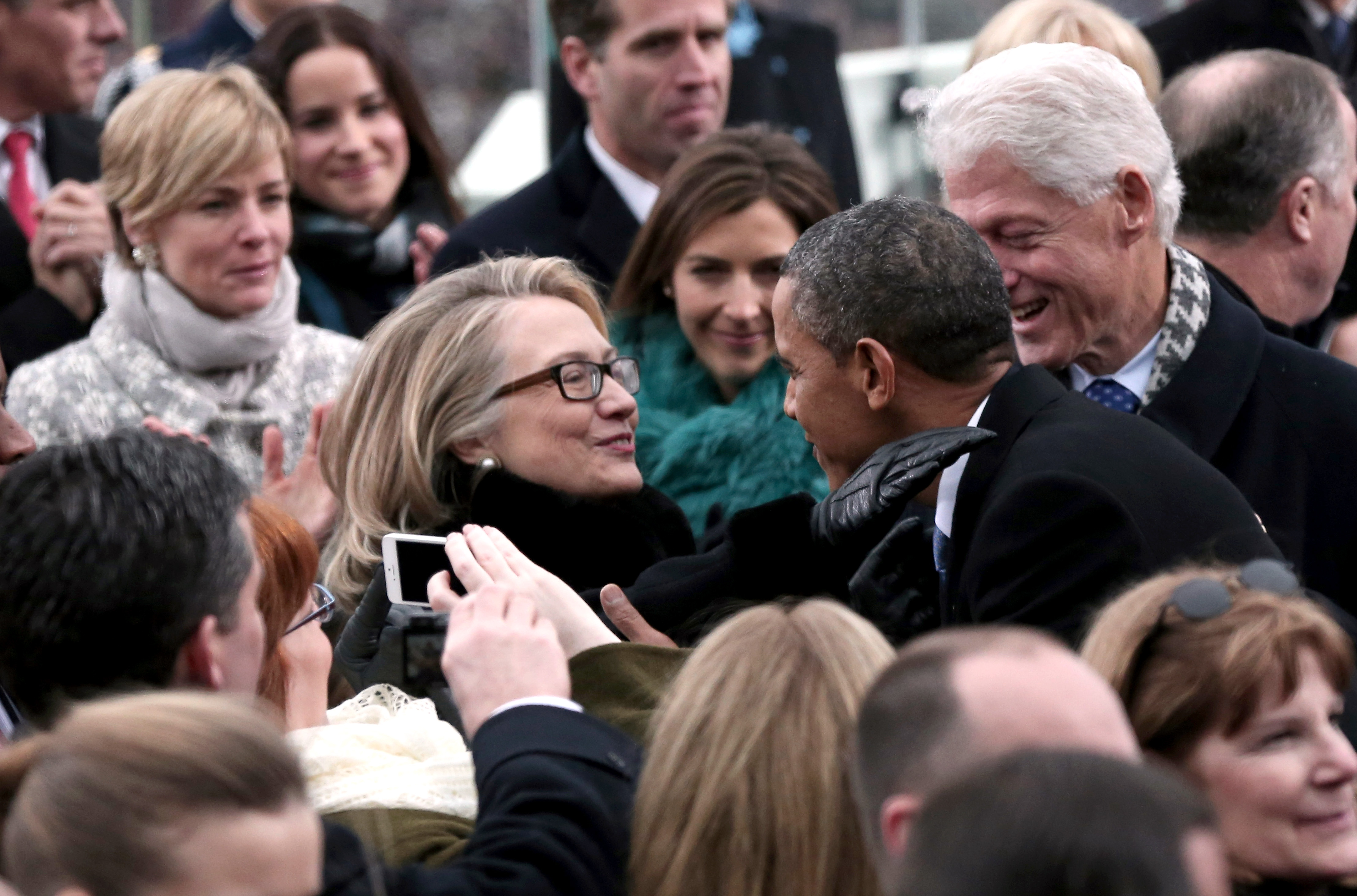 January 2013 President Barack Obama greets then-Secretary of State Hillary Clinton and former president Bill Clinton during the presidential inauguration on the West Front of the U.S. Capitol on Jan. 21, 2013 in Washington when Obama was re-elected for a second term.