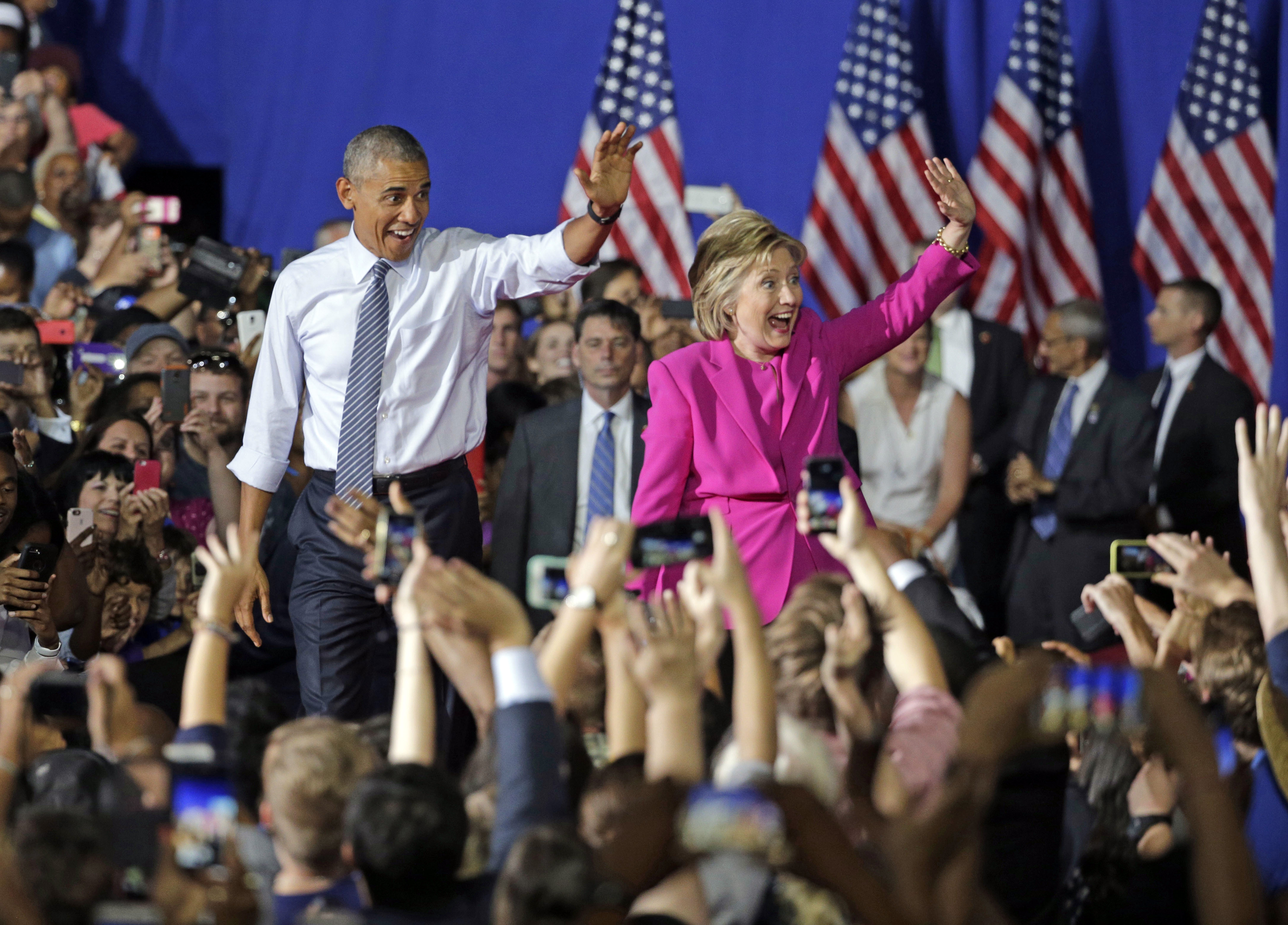 July 2016 President Barack Obama and Democratic presidential candidate Hillary Clinton wave to the crowd during a campaign rally for Clinton in Charlotte, N.C., on July 5, 2016.