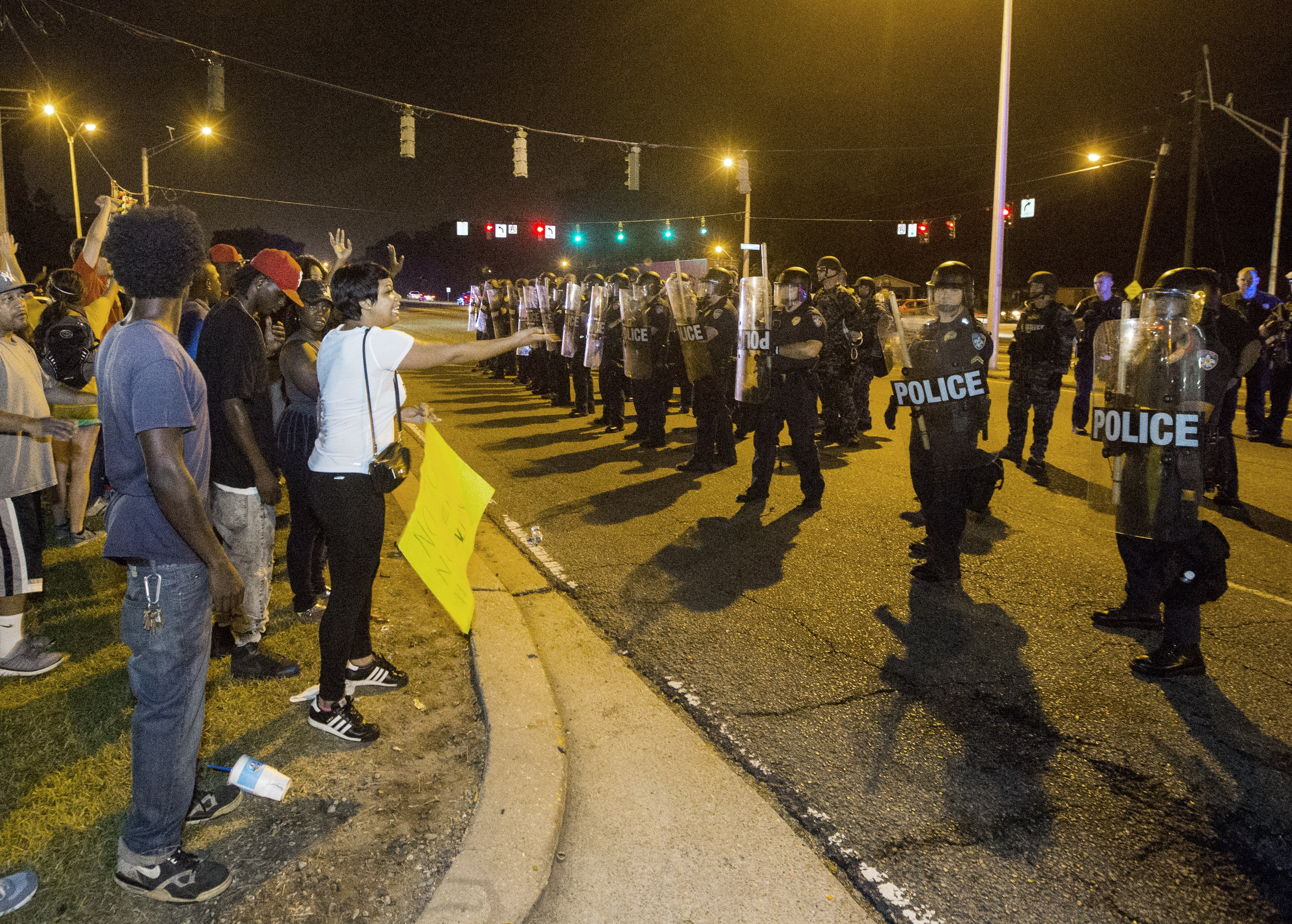 People gather to protest against the shooting of Alton Sterling on July 10, 2016 in Baton Rouge, Louisiana.