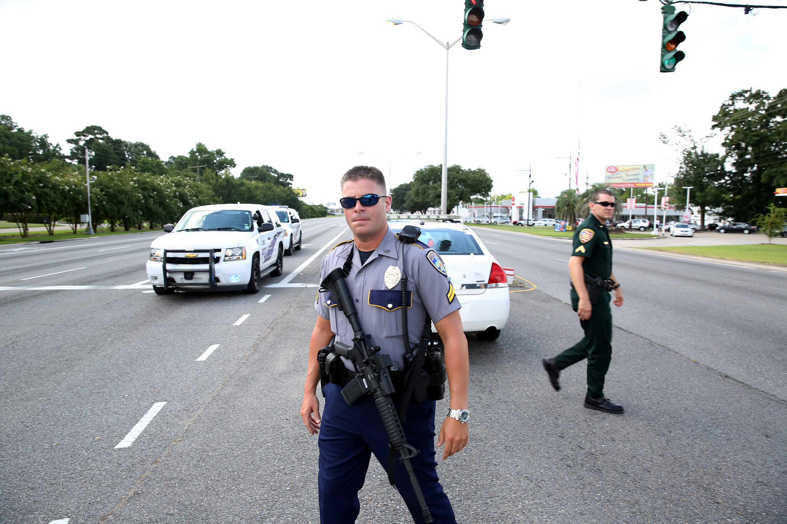 Police officers block off a road after a shooting of police in Baton Rouge, Louisiana, July 17, 2016.